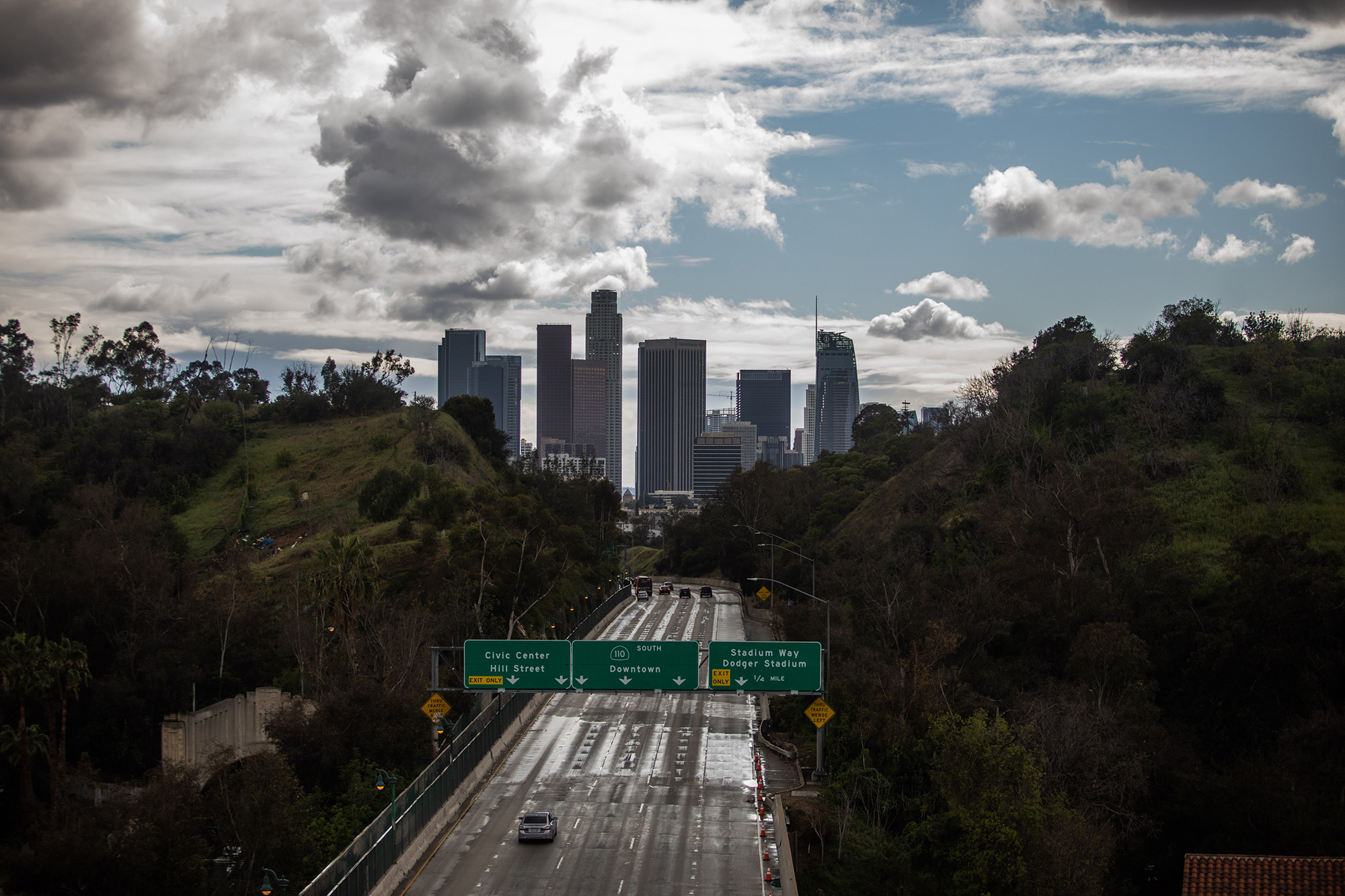 Freeway 110 is pictured with downtown Los Angeles, California in the background on March 19, 2020.
