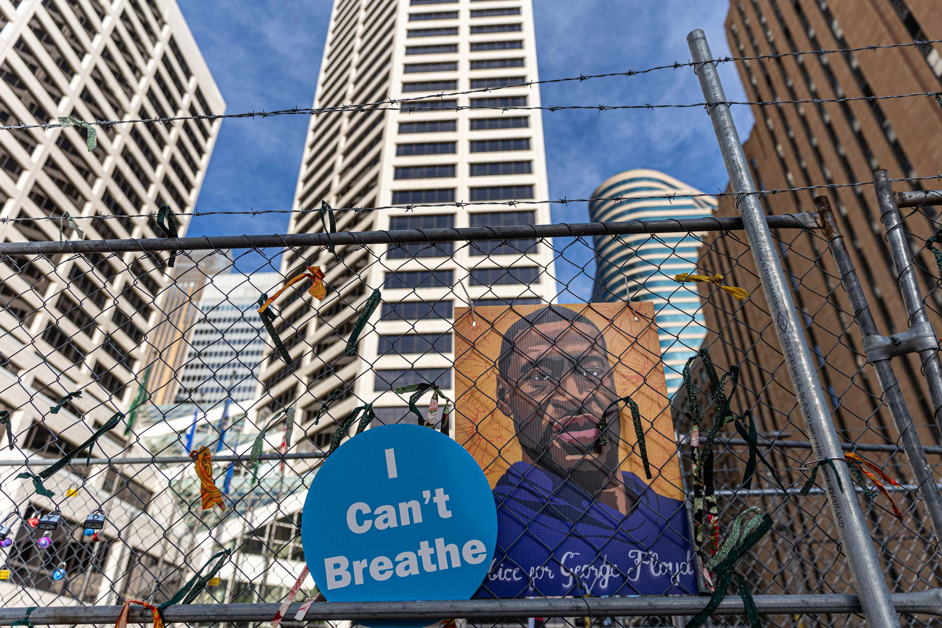 A poster with George Floyd's picturehangs from a security fence outside the Hennepin County Government Center on March 30 in Minneapolis, Minnesota.