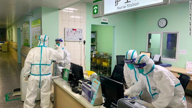 Medical staff members wear protective suits at the Zhongnan hospital in Wuhan.