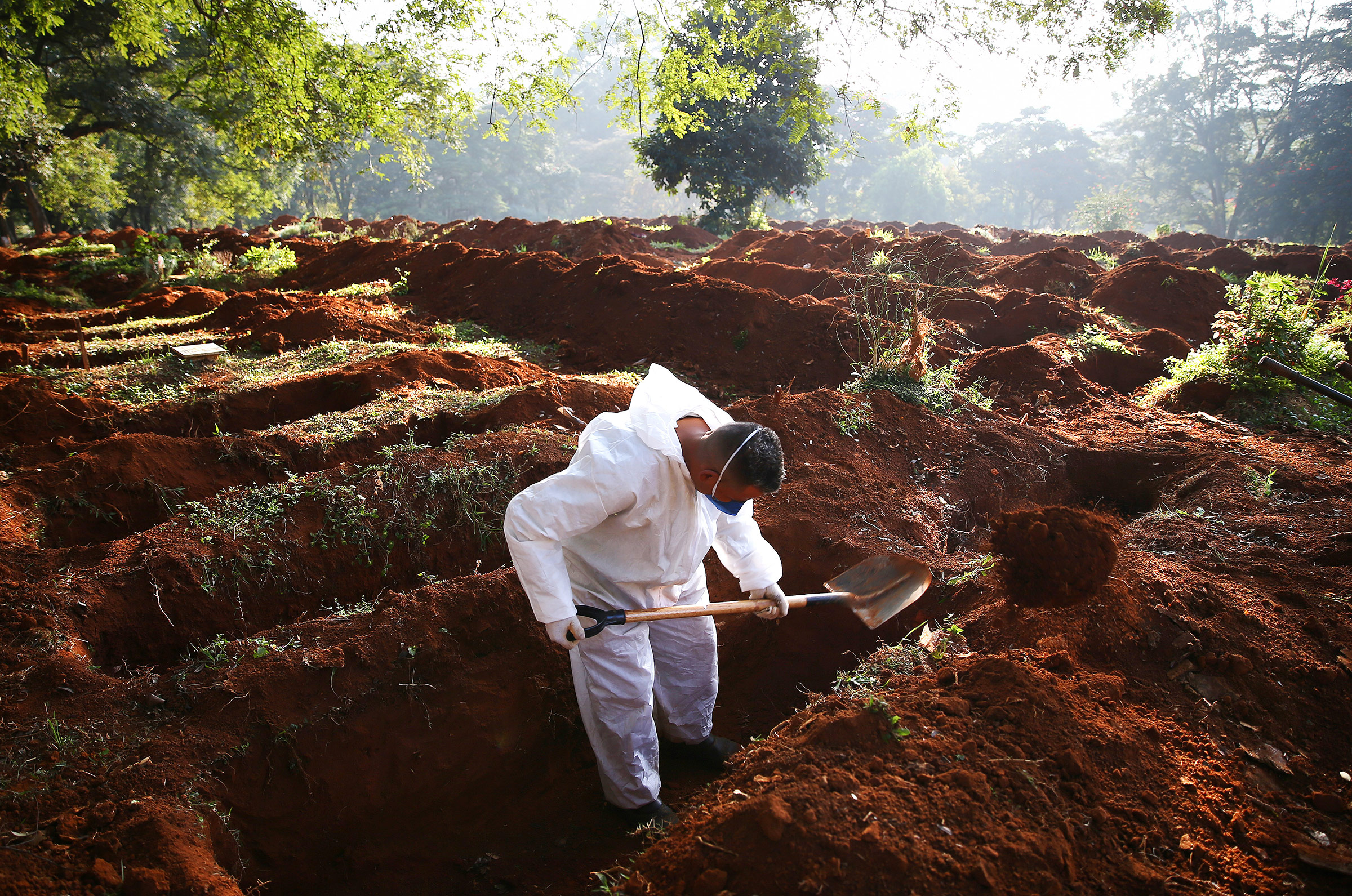 A cemetery worker digs a grave for a Covid-19 victim at Vila Formosa cemetery in Sao Paulo, Brazil, on May 19.