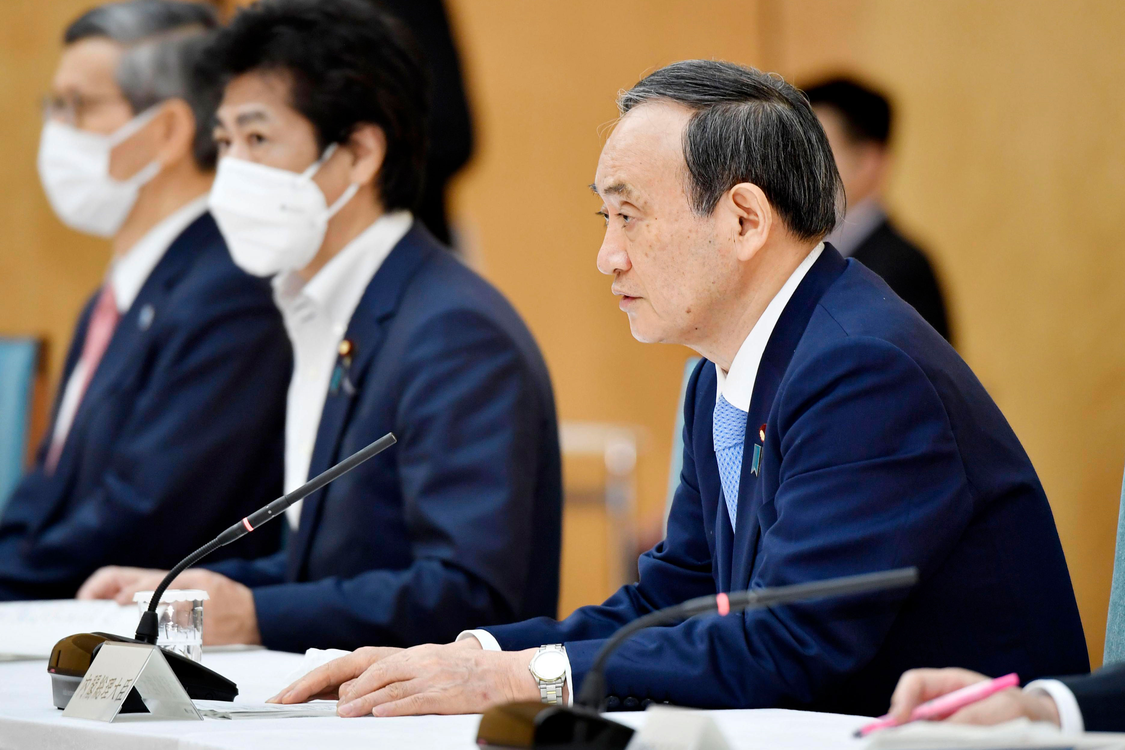 Japanese Prime Minister Yoshihide Suga, right, attends a meeting about Covid-19 in Tokyo on May 28.
