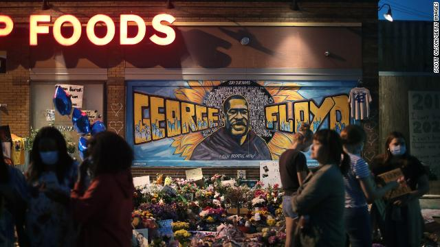 People visit a memorial on June 3 at the site where George Floyd was killed in Minneapolis.
