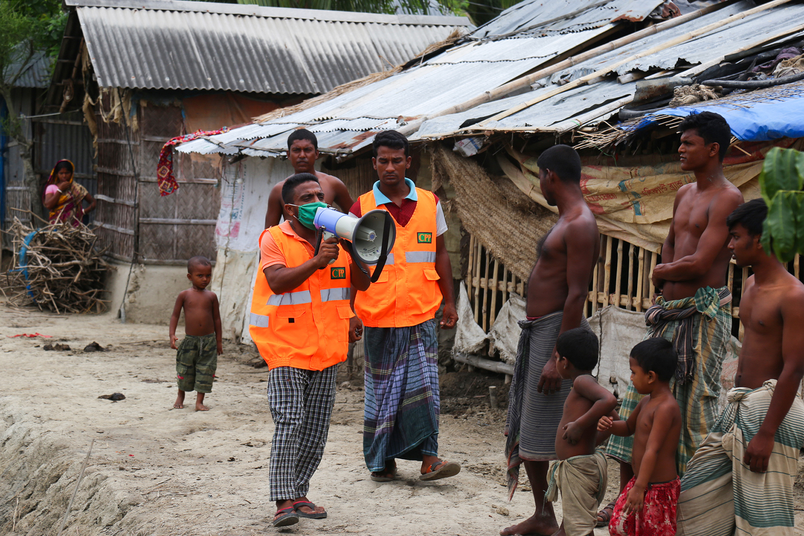 A cyclone preparedness program volunteer uses a megaphone to urge residents to evacuate to shelters ahead of the expected landfall of Super Cyclone Amphan in Khulna, Bangladesh on May 19.