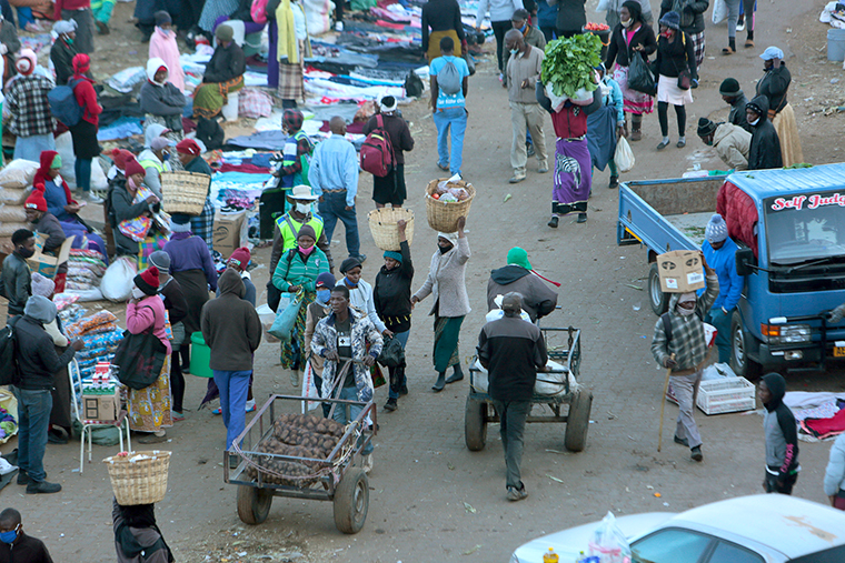 People visit a fruit and vegetable market in Harare, Zimbabwe, on Monday, July 20.