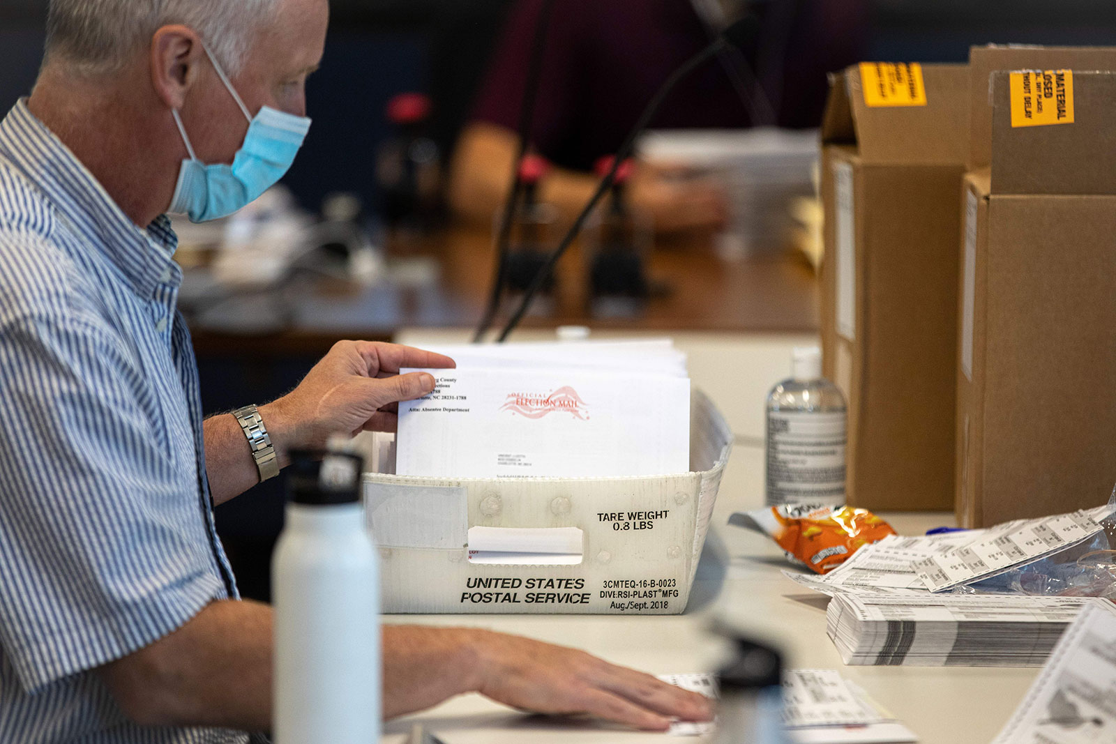An election worker stuffs absentee ballot applications at the Mecklenburg County Boards of Elections office in Charlotte, North Carolina, on September 4.