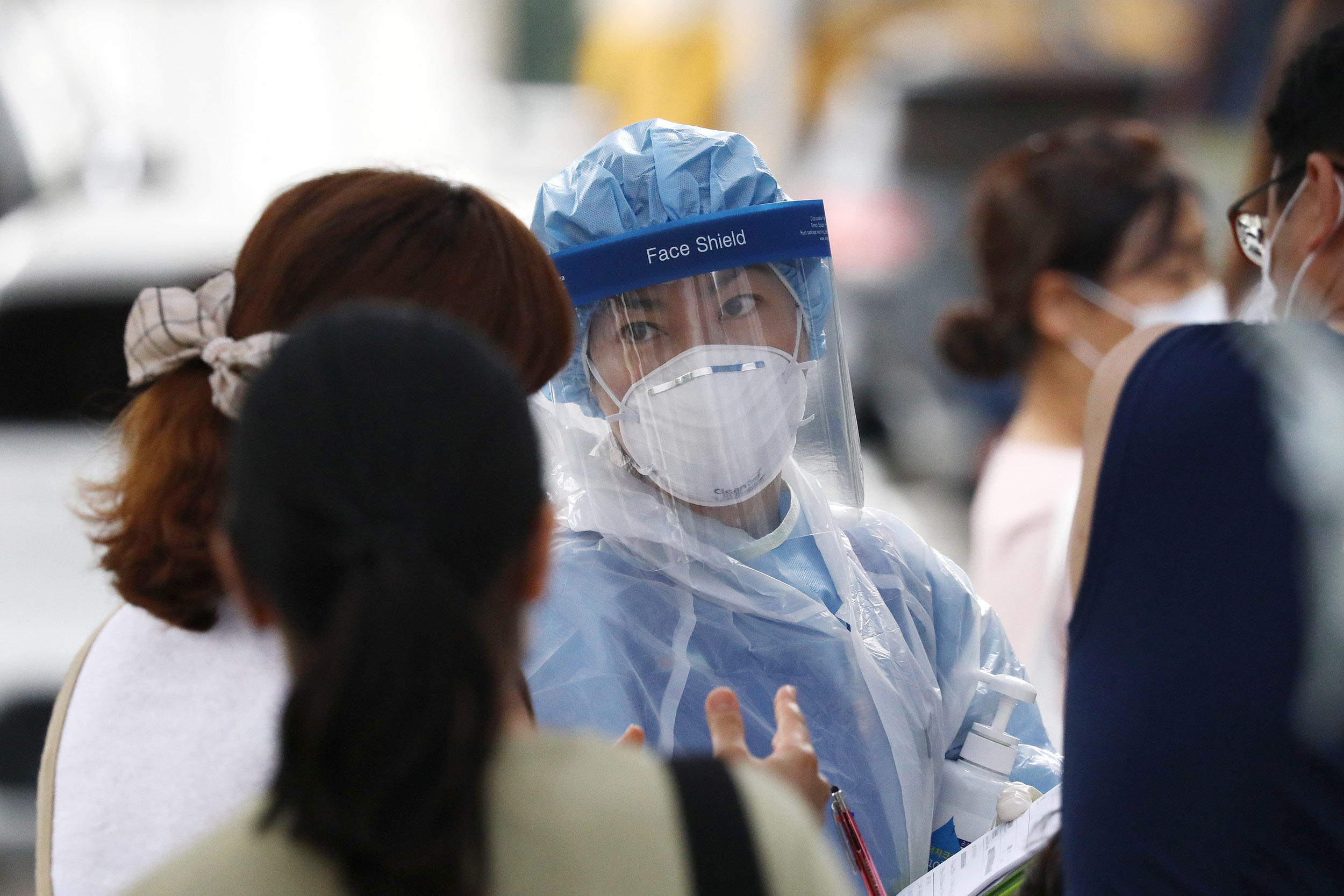 A medical worker screens for Covid-19 at a testing facility on August 26, in Seoul, South Korea.