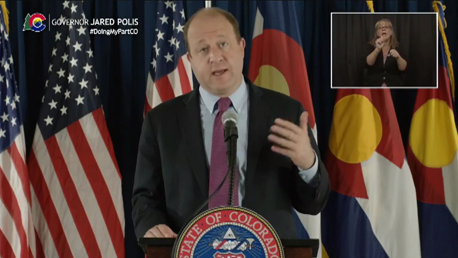 Colorado Gov. Jared Polis speaks during a press conference on Tuesday.