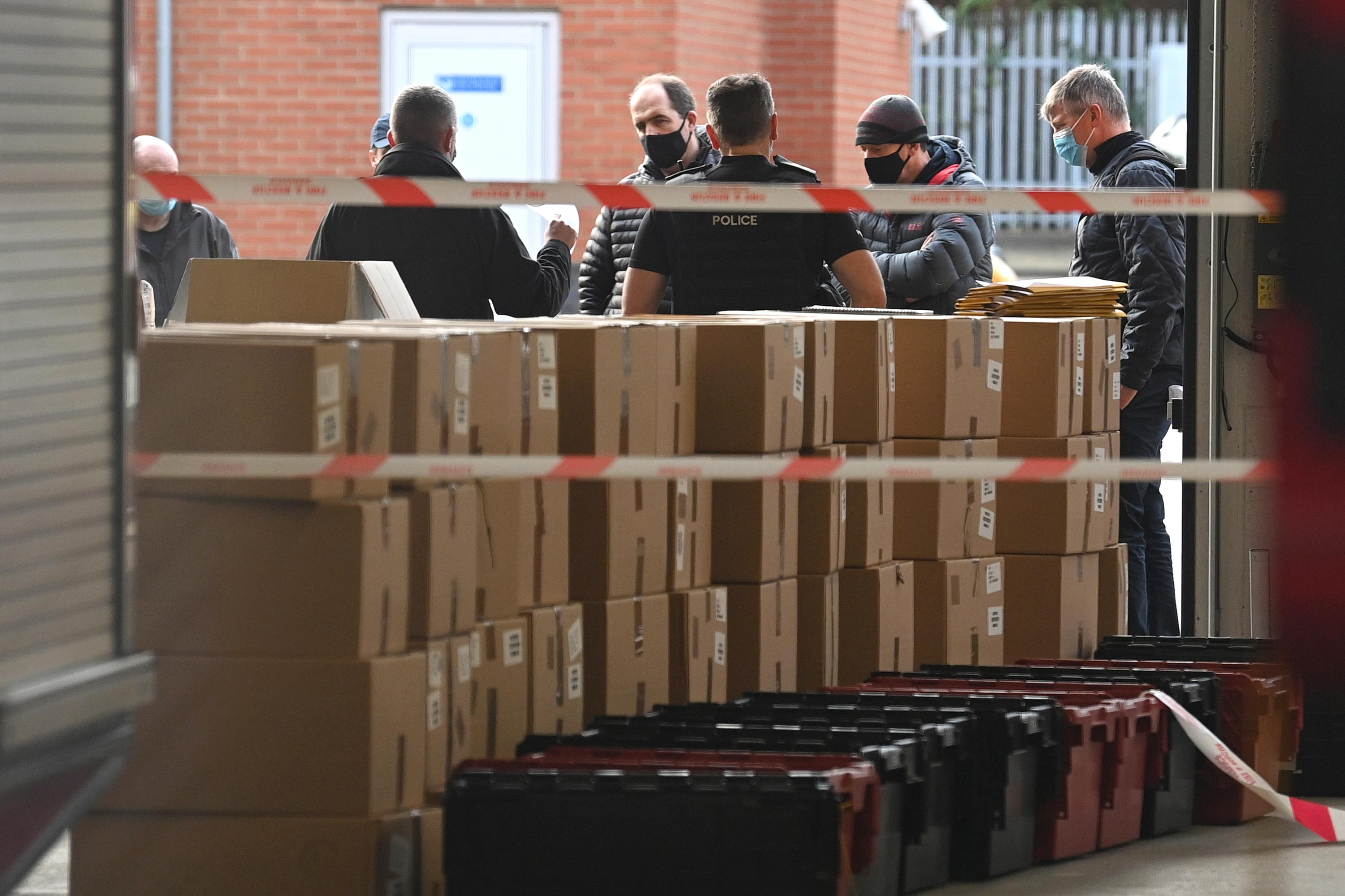 Stock of test kits is pictured at Woking fire station as local authorities prepare to deploy Covid-19 testing in an effort to track down a South African coronavirus variant found in the area.