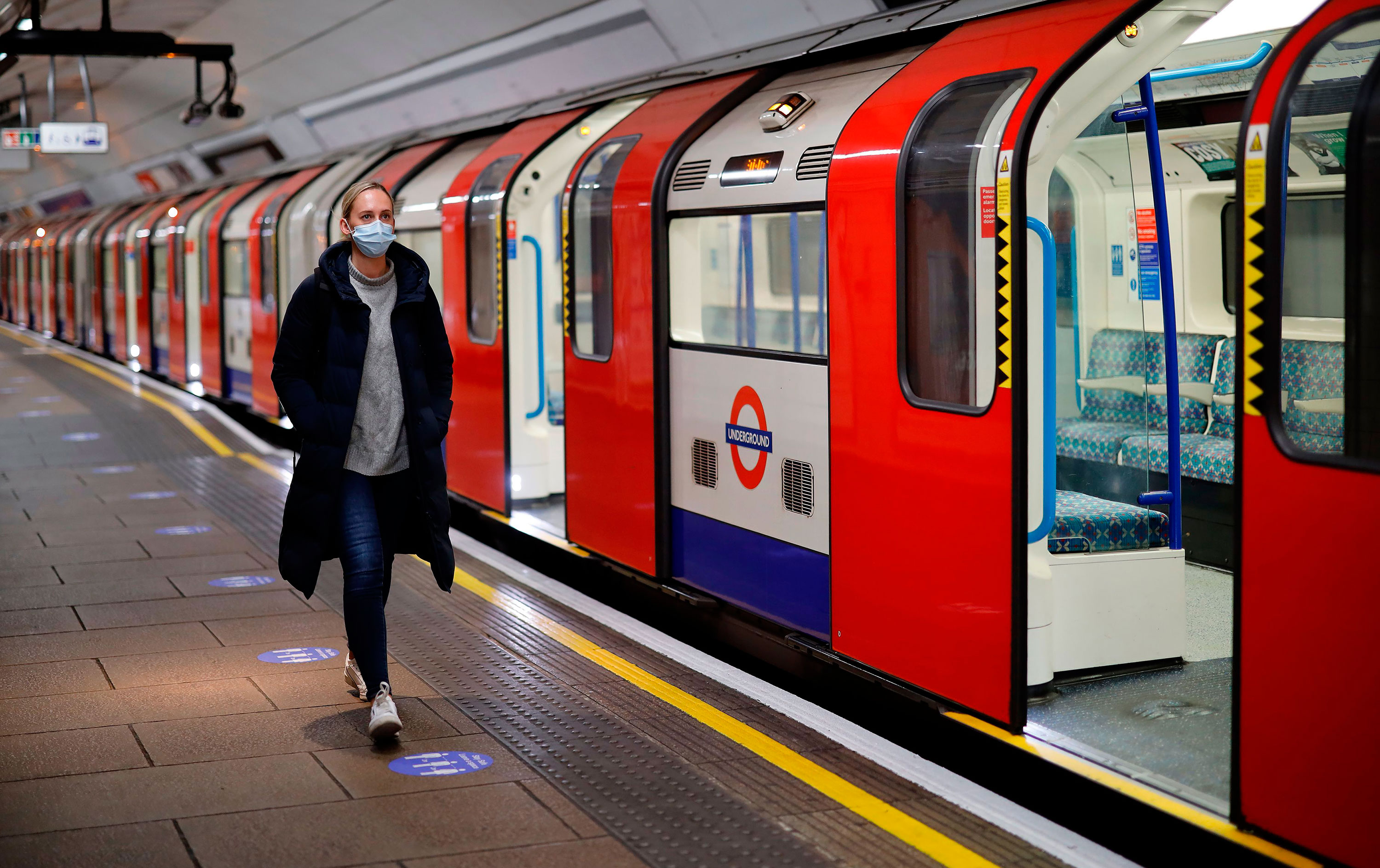 A woman walks along a London Underground platform on May 11 in London.