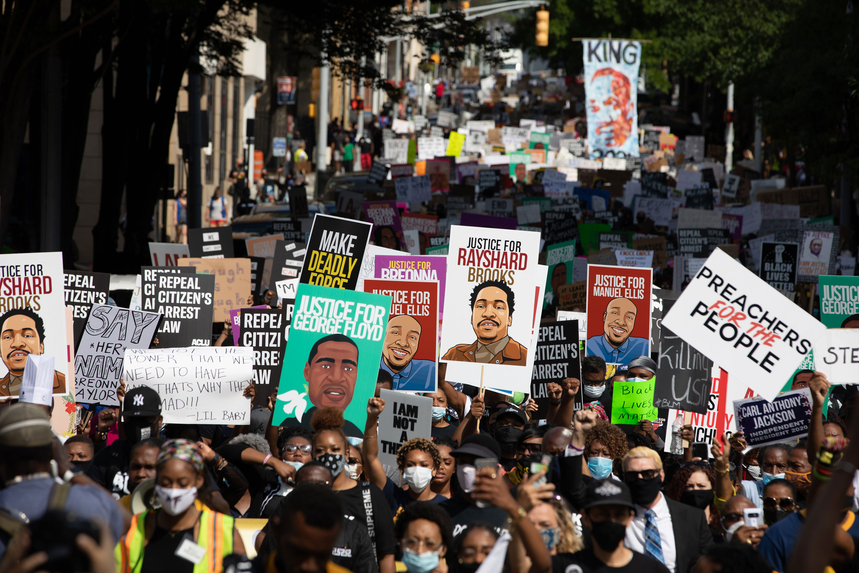 Protesters take part in a march organized by NAACP on June 15 in Atlanta.
