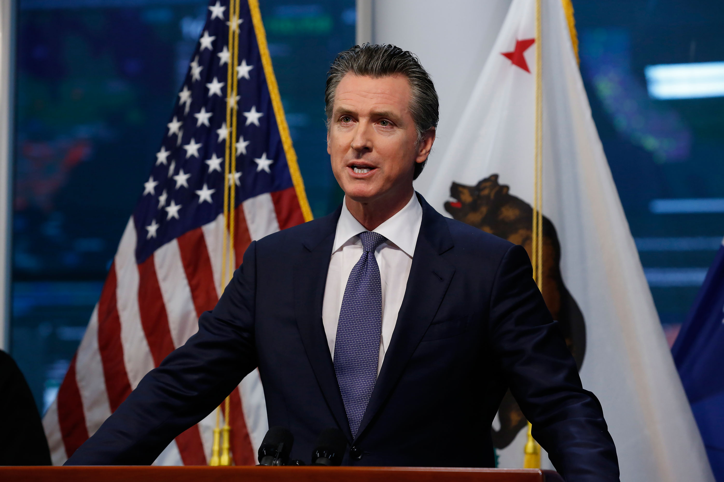 Gov. Gavin Newsom updates California's response to the coronavirus at the Governor's Office of Emergency Services in Rancho Cordova, California, on Monday, March 23.