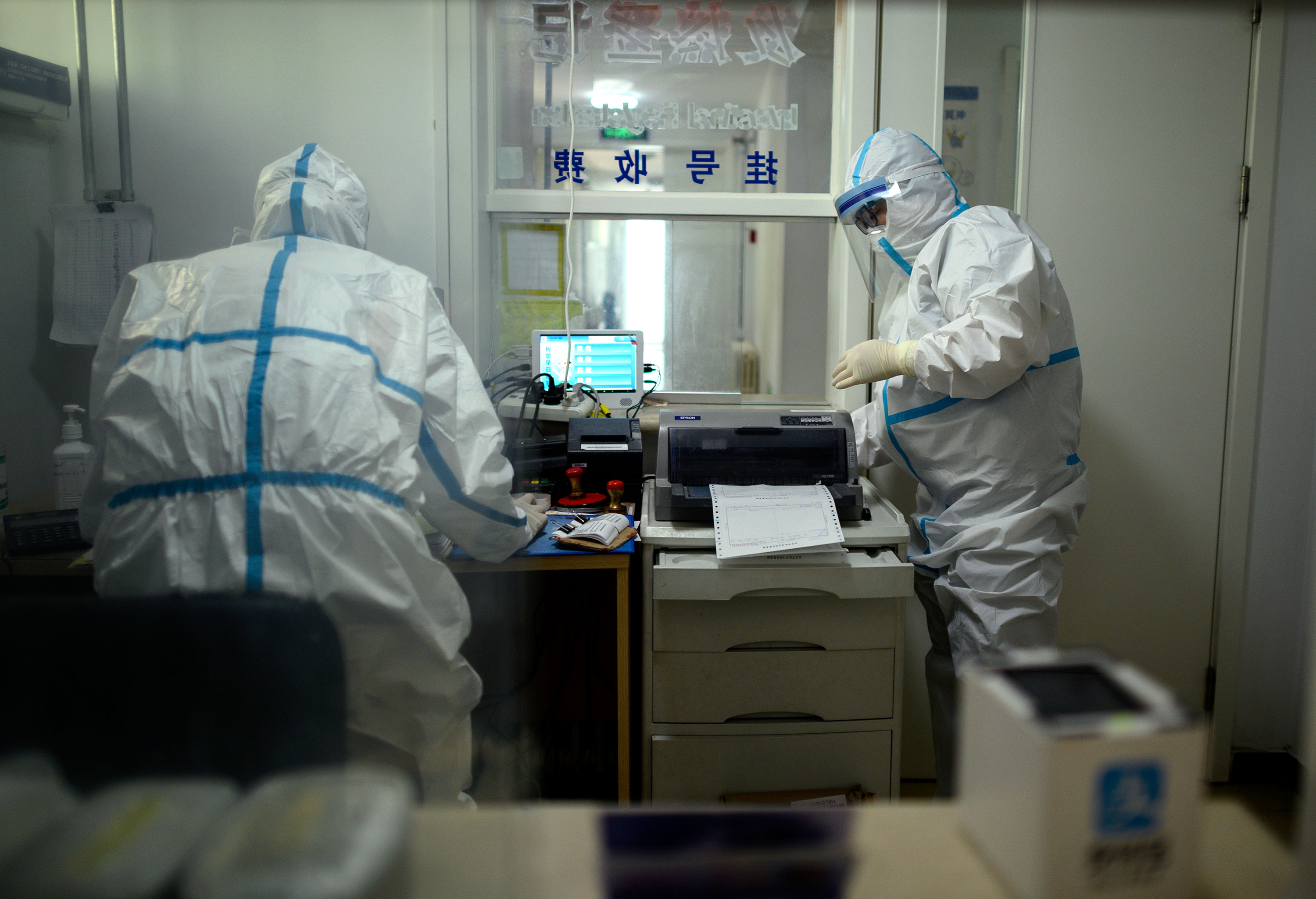 Medical staff work inside a testing clinic in Beijing, China, on April 29.