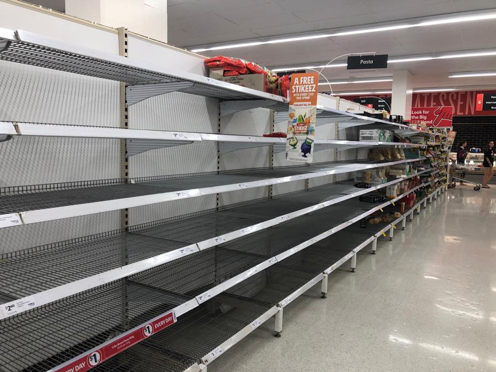 Empty shelves in the pasta section of Coles supermarket at Greenslopes Mall in Brisbane, Australia.