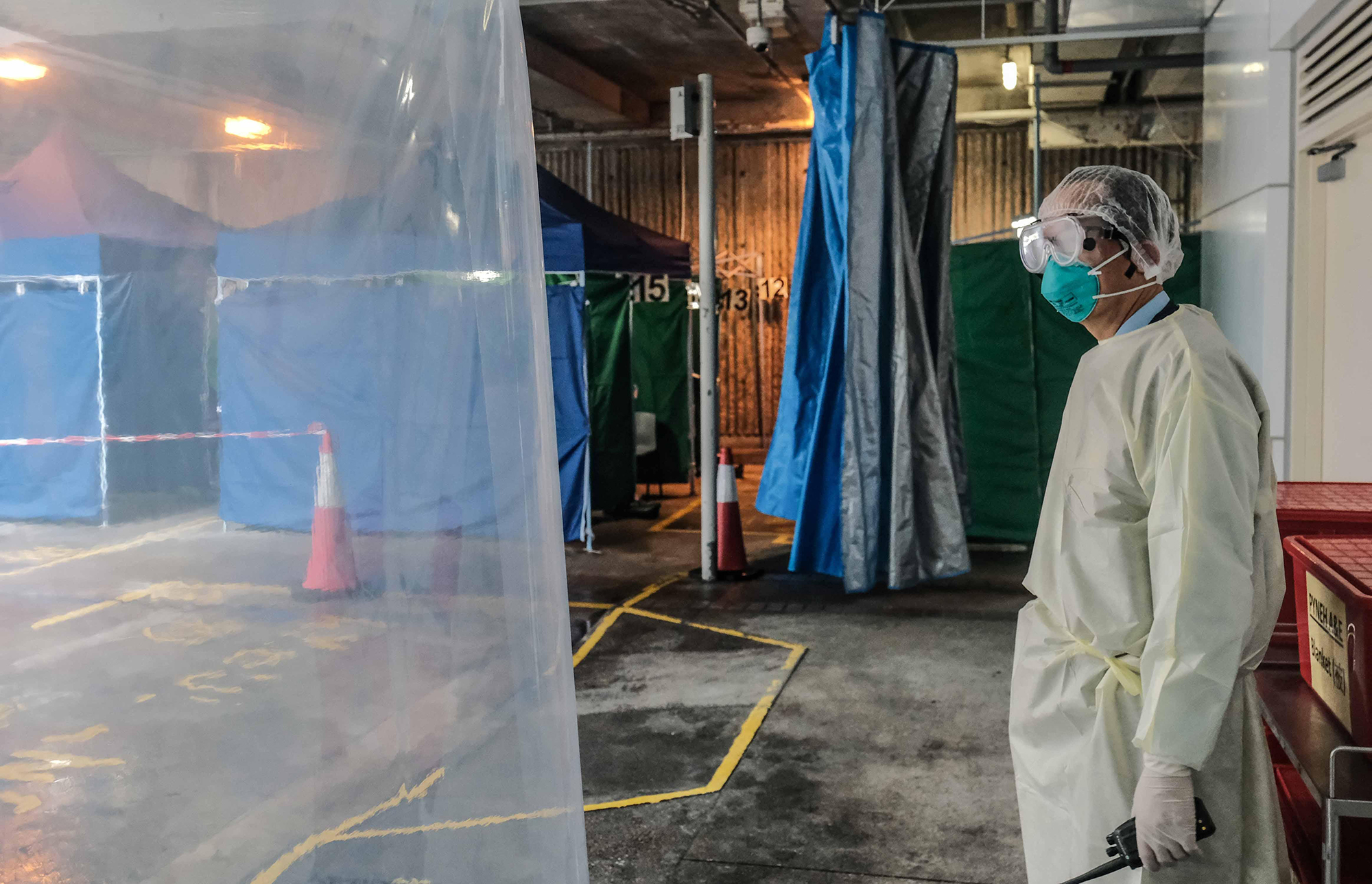 A medical worker stands at a site for Covid-19 tests in Pamela Youde Nethersole Eastern Hospital on March 31 in Hong Kong.