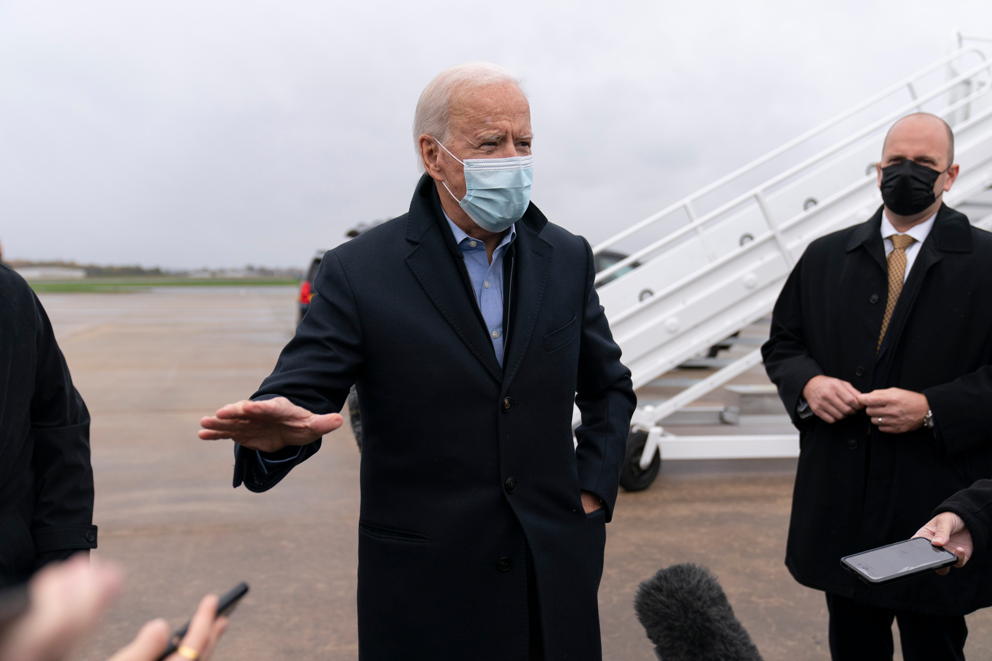 Democratic presidential candidate Joe Biden speaks to members of the media before boarding his campaign plane at New Castle Airport in New Castle, Delaware, on October 30.