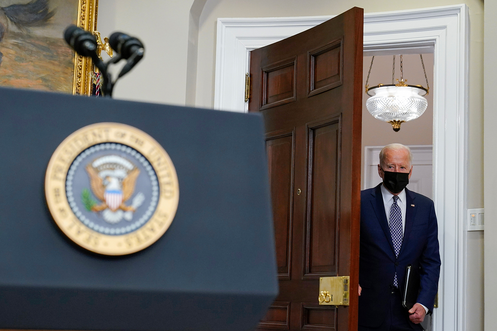 President Joe Biden arrives to speak about the situation in Afghanistan from the Roosevelt Room of the White House in Washington on Tuesday, August 24.
