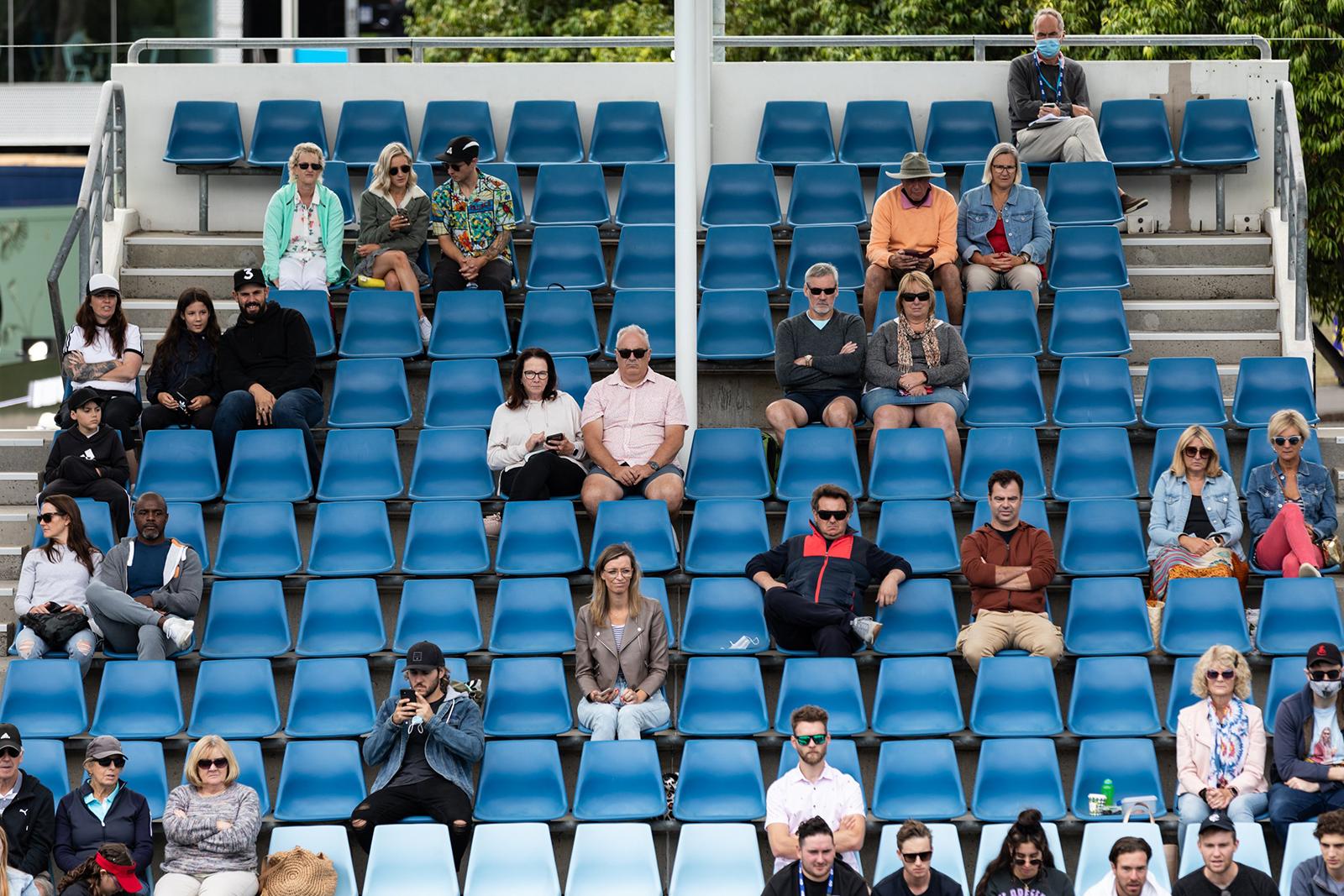 Socially distanced spectators watch a match on Court 3.