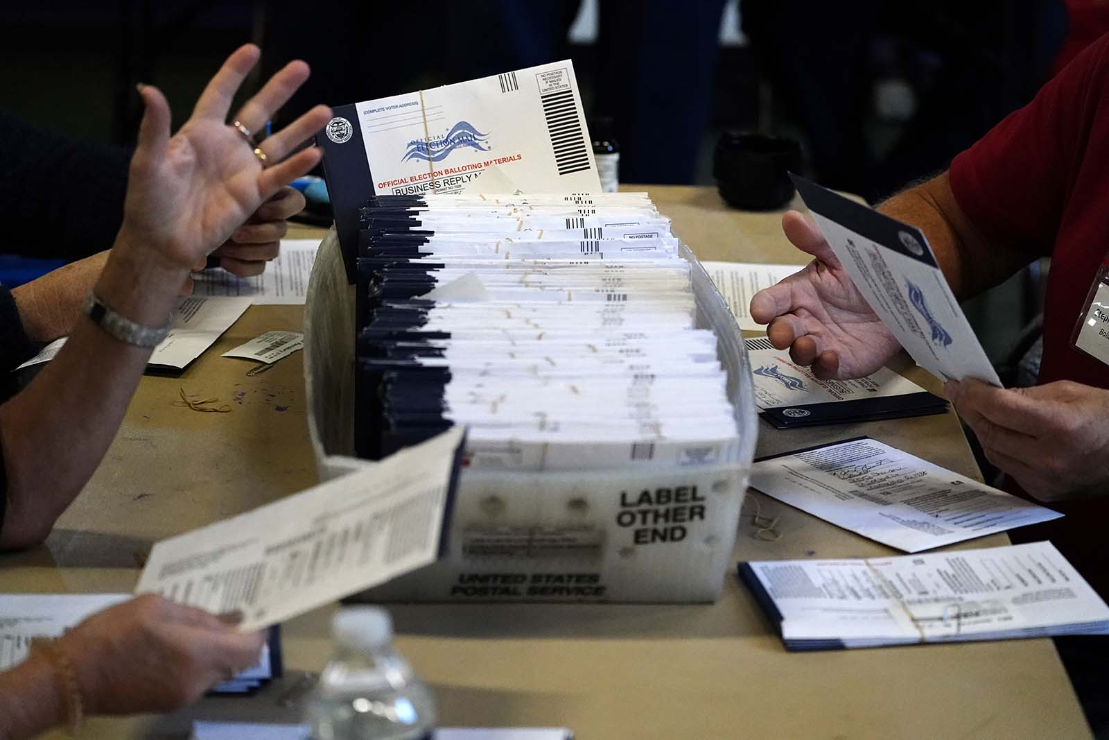 Chester County election workers process mail-in and absentee ballots for the 2020 general election in the United States at West Chester University on Wednesday, November 4, in Pennsylvania.