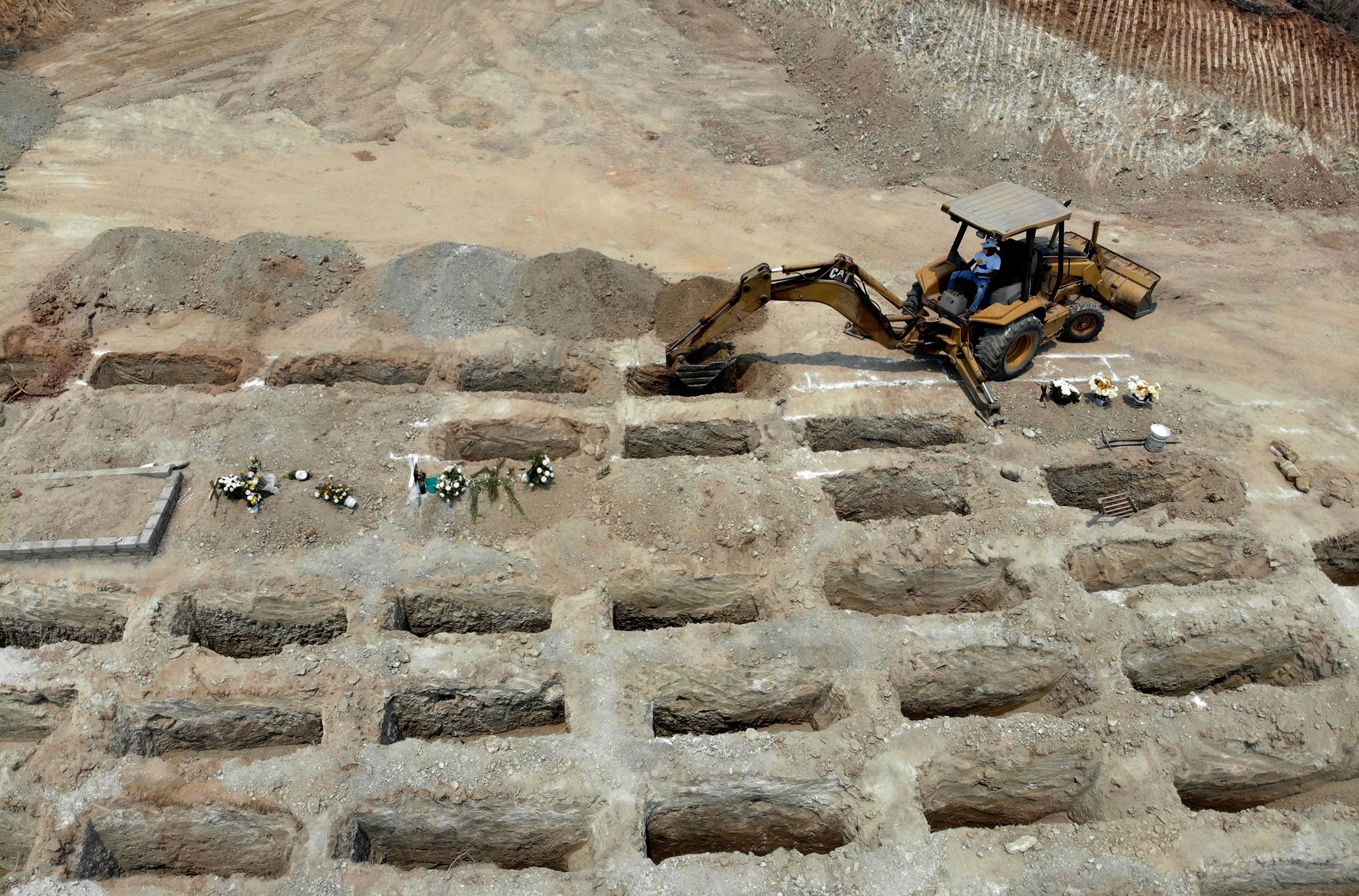 Workers dig 300 graves at the El Palmar Phanteon for coronavirus victims in Acapulco, Mexico on May 22.