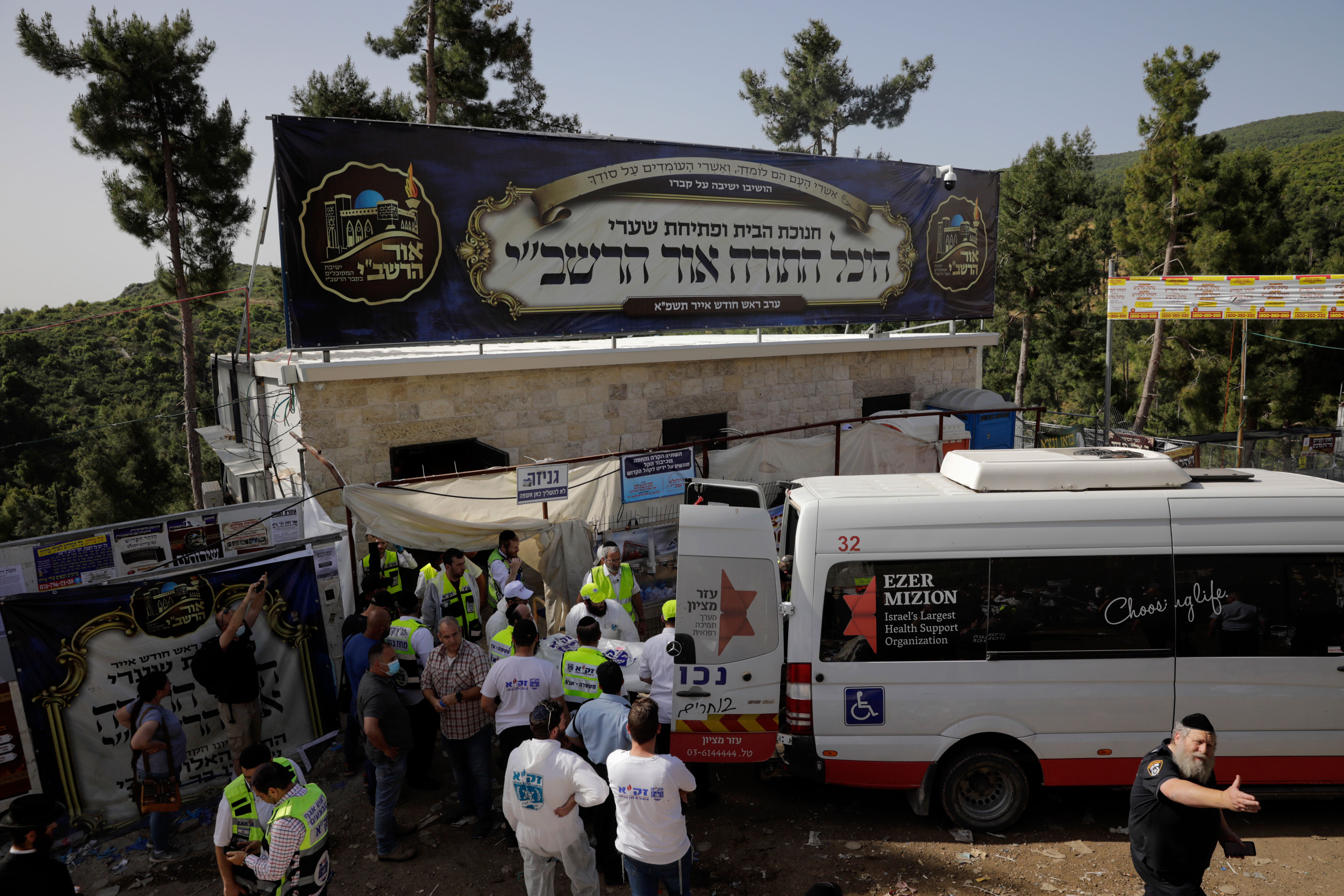 On Friday, rescuers worked to transport the bodies of those who died in the disaster.