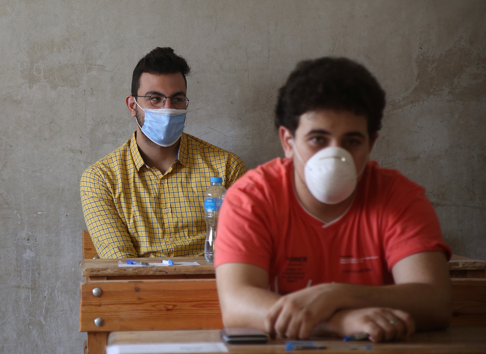 Students wearing face masks are seen at a high school exams site in Cairo, Egypt, on June 21.