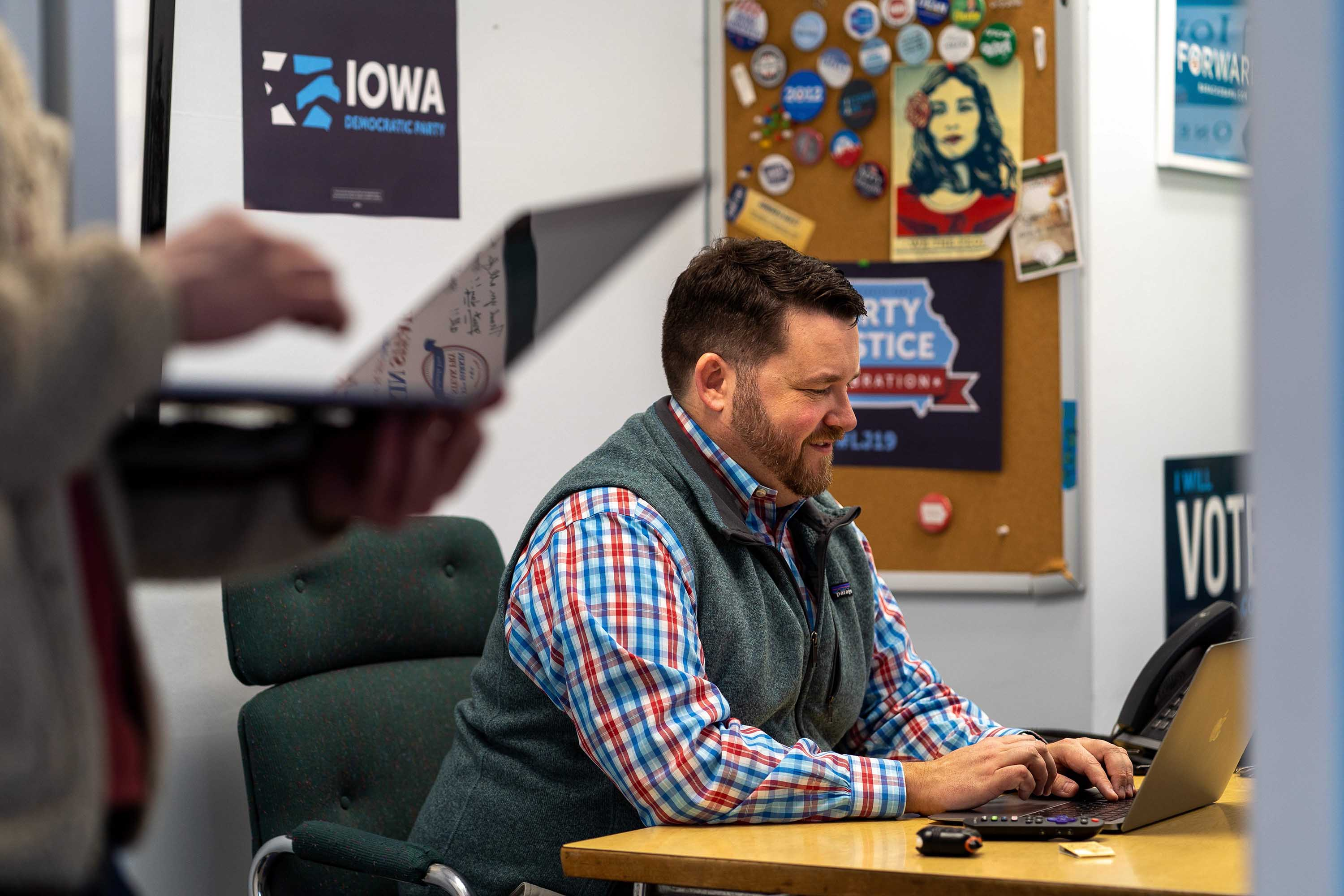 Iowa Democratic Party Chair Troy Price works in his office in Des Moines, Iowa on January 30.