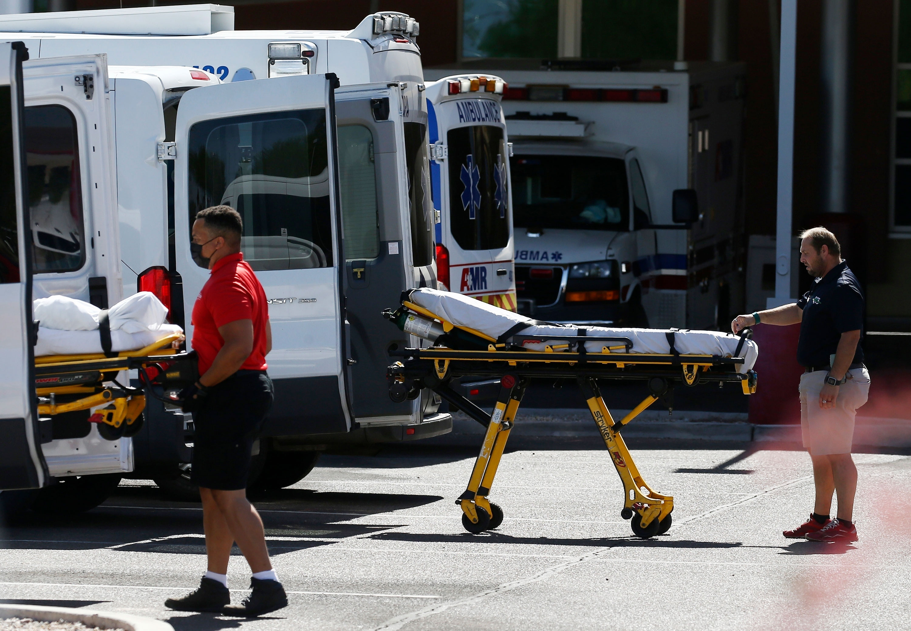 Ambulances are parked outside the emergency room entrance at Banner Desert Medical Center, on June 16 in Mesa, Arizona.