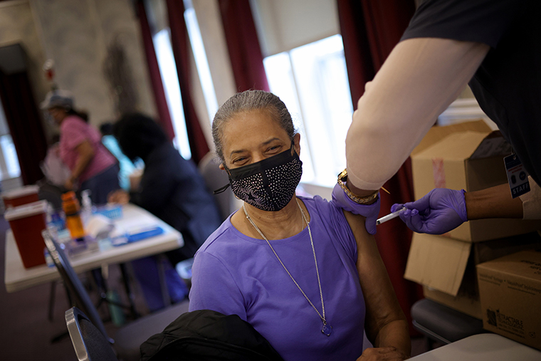 Maryland residents receive their second dose of the Moderna coronavirus vaccine at the Cameron Grove Community Center on March 25, 2021 in Bowie, Maryland.