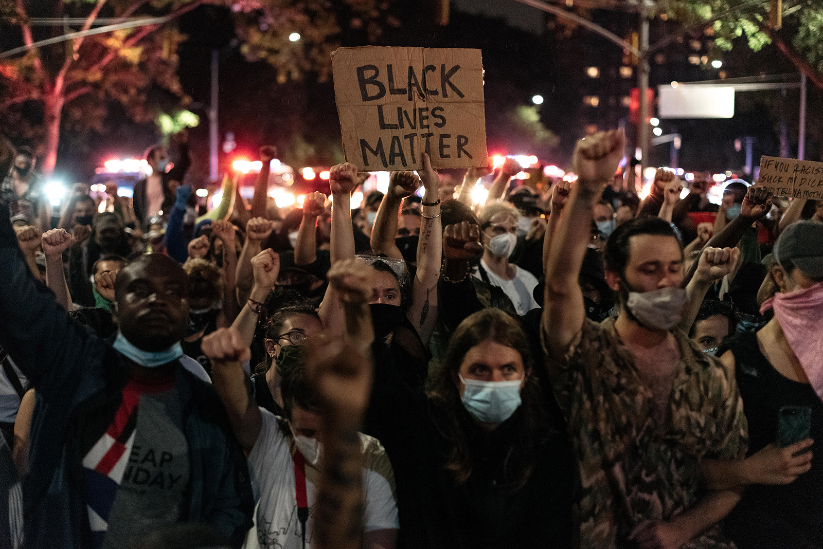 Protesters denouncing systemic racism in law enforcement march in defiance of a citywide curfew on June 5, in New York City.