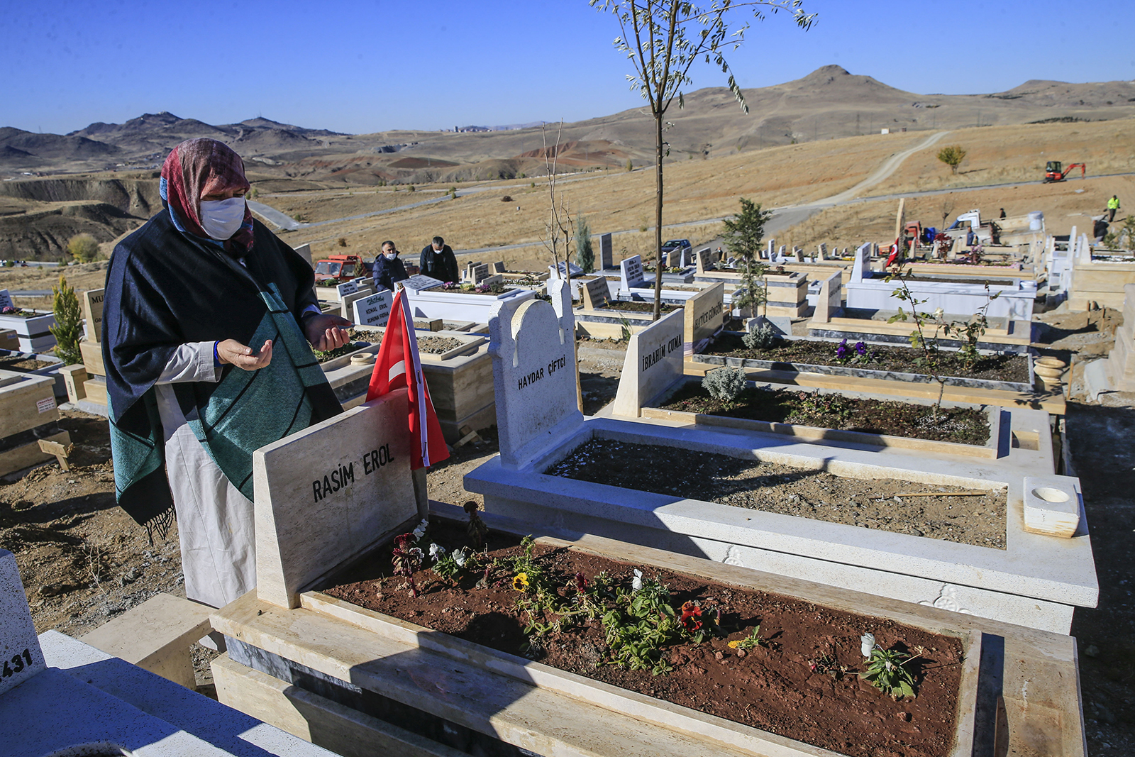 Relatives of Covid-19 victims visit graves at Ortakoy cemetery in Ankara, Turkey, on November 24.