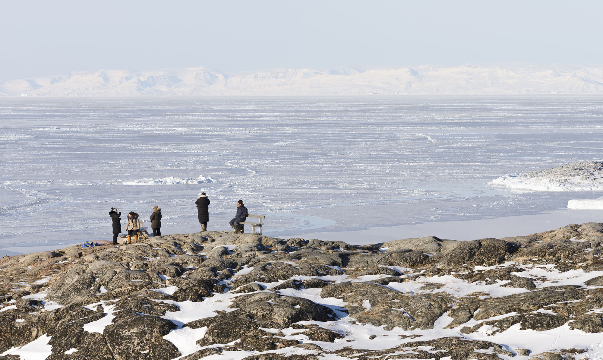 Tourists are looking at the frozen Disko Bay during winter in West Greenland, on July 28, 2020