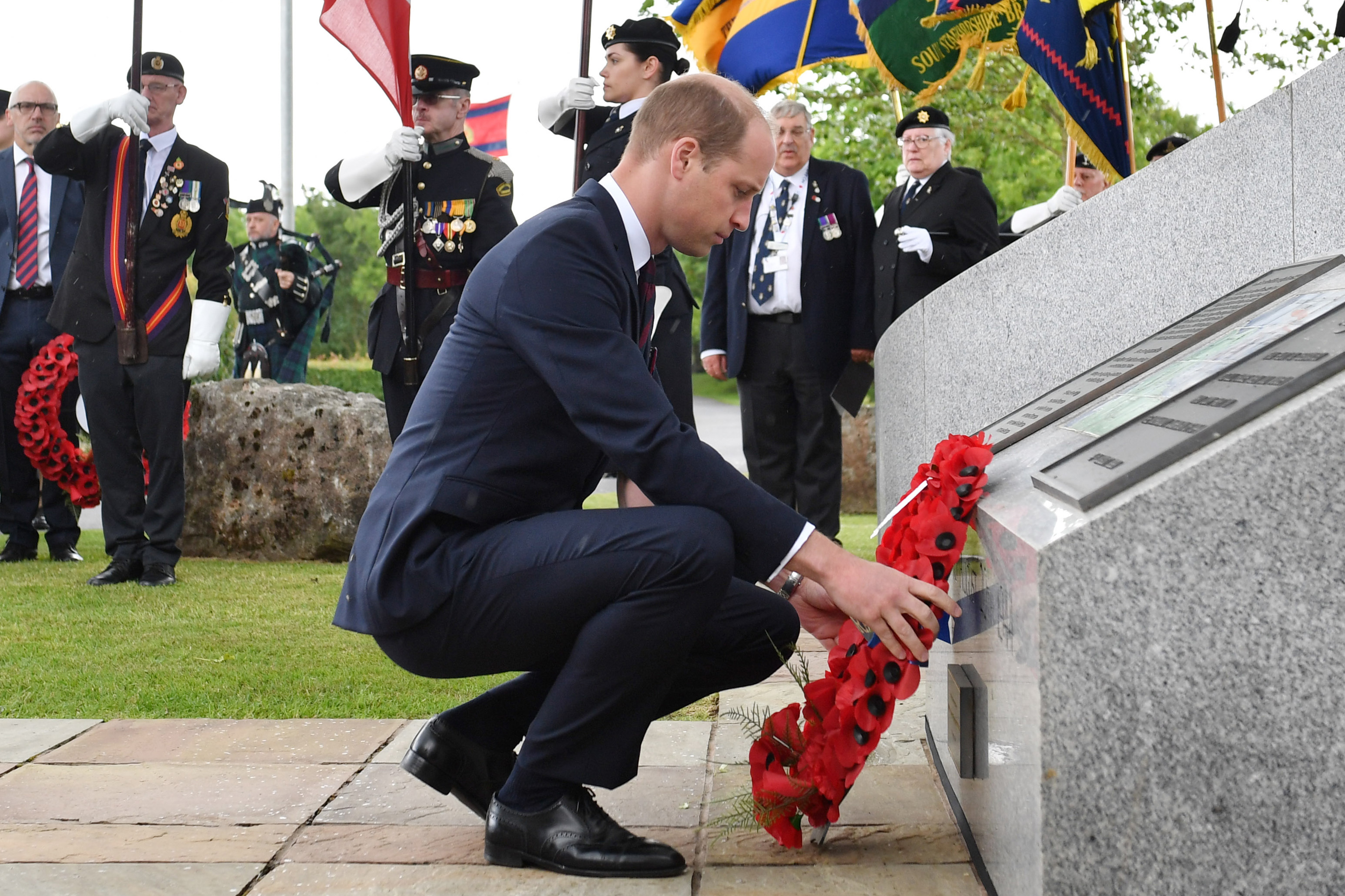 Prince William lays a wreath in Staffordshire, central England.