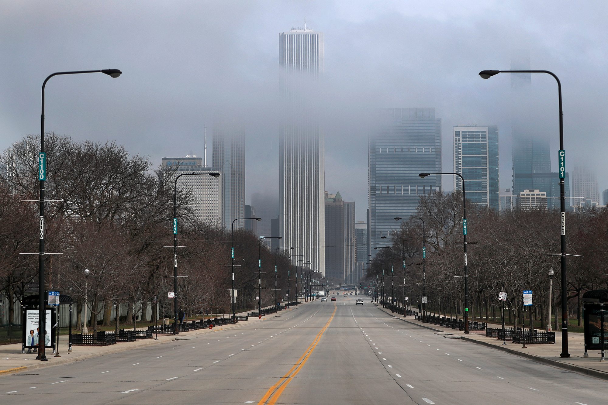 Fog lifts over Chicago and the usually busy Columbus Drive, Tuesday, March 24, on the second work day since Illinois Gov. J.B. Pritzker gave a shelter in place order last week due to the coronavirus.