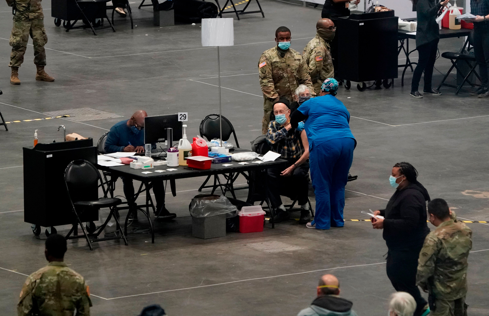 People are vaccinated at the Jacob K. Javits Convention Center on January 13 in New York City.
