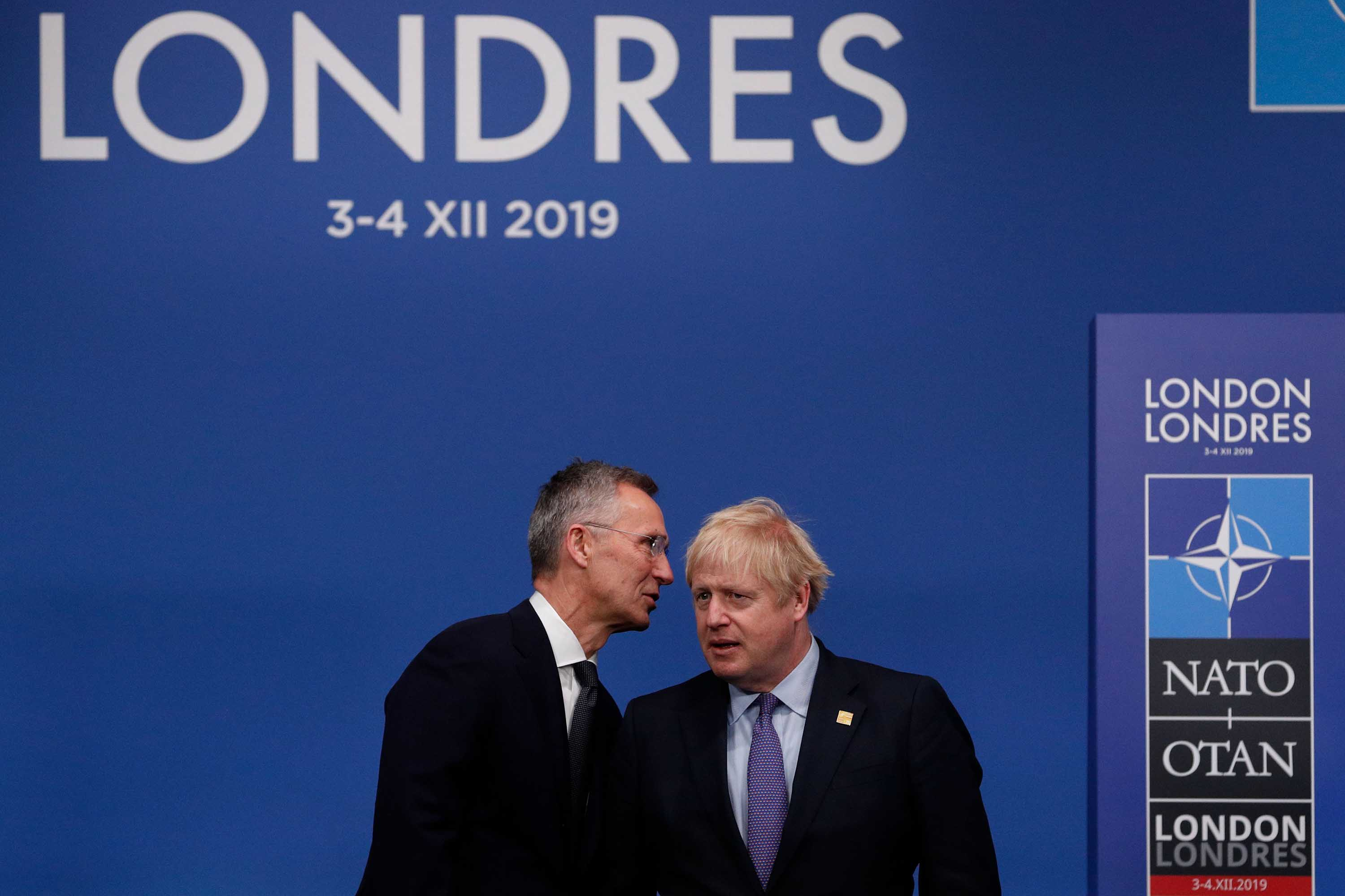 NATO Secretary General Jens Stoltenberg speaks with Prime Minister Boris Johnson at the NATO leaders meeting on Wednesday. Photo: Adrian Dennis/AFP via Getty Images