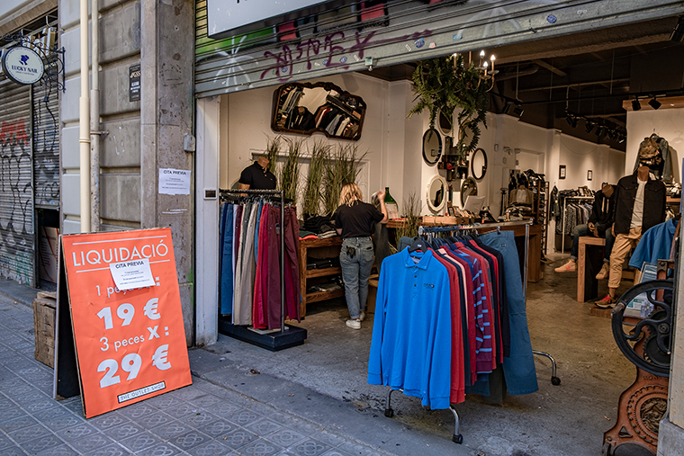 A clothing store is open to the public by appointment in Barcelona, on May 13.