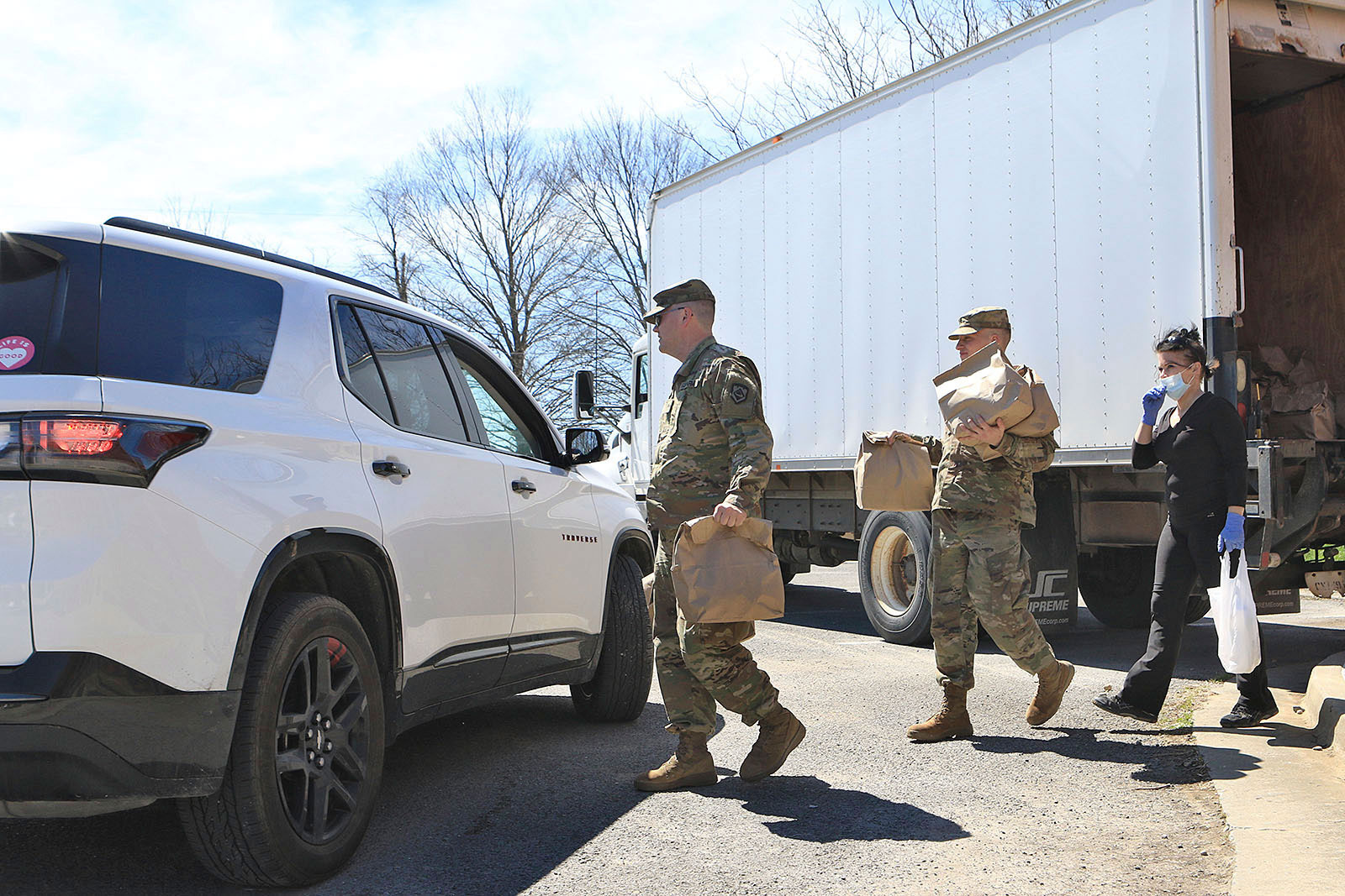 West Virginia National Guard members distribute bags meals for students at Mountain View Elementary School in Union, West Virginia on March 30.