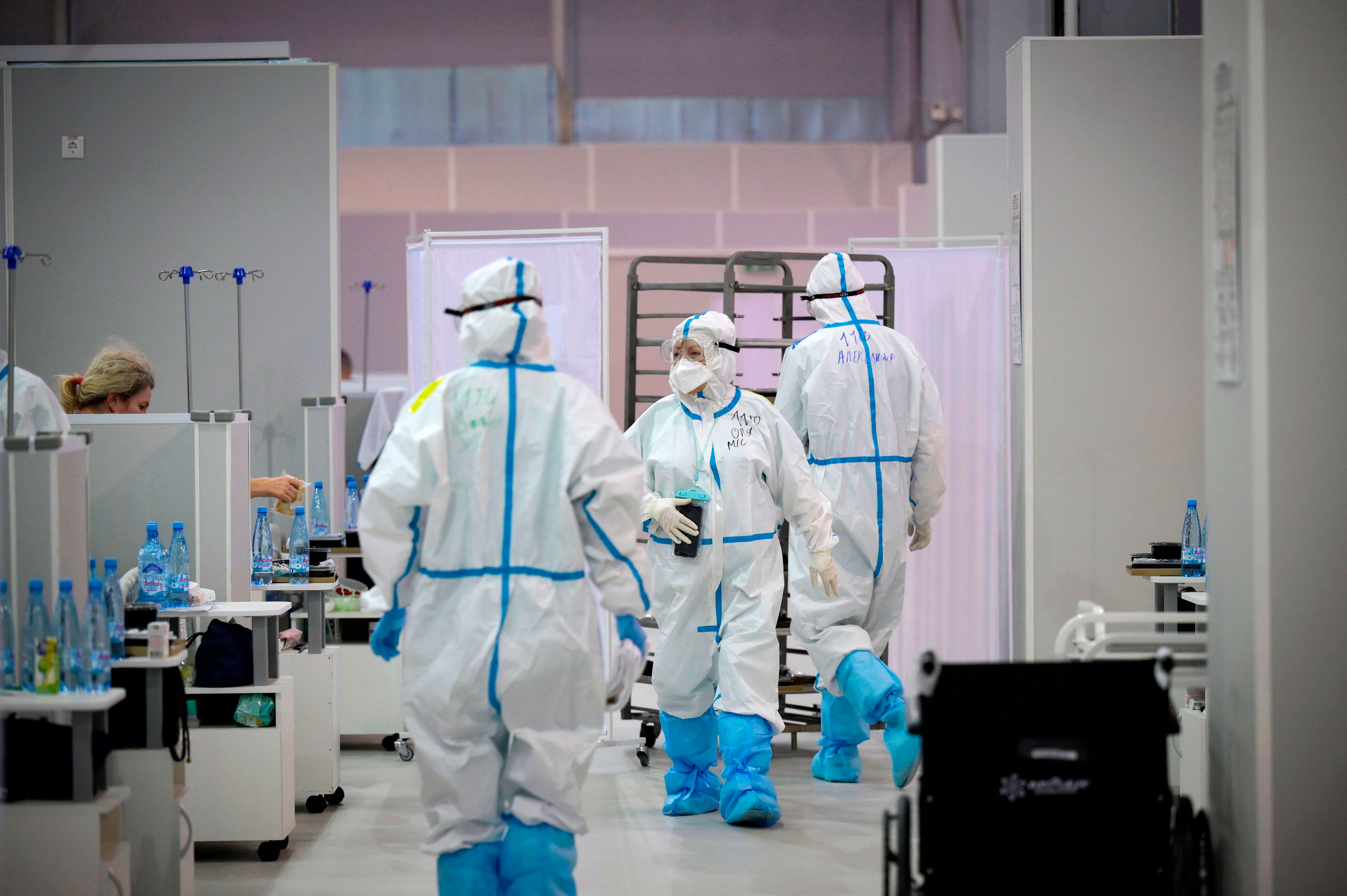 Medical personnel in Moscow work in a temporary hospital for coronavirus patients on November 9.