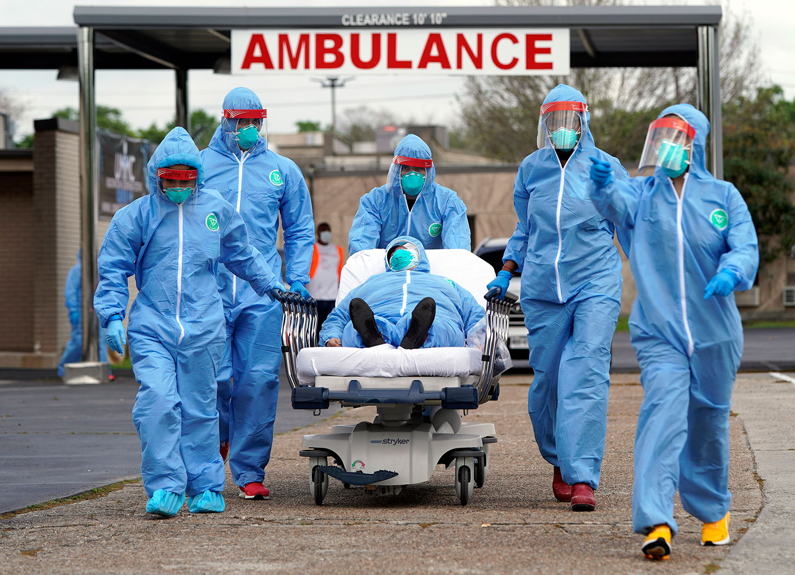 Medical workers take a patient on a gurney into United Memorial Medical Center in Houston, Texas, on March 19.