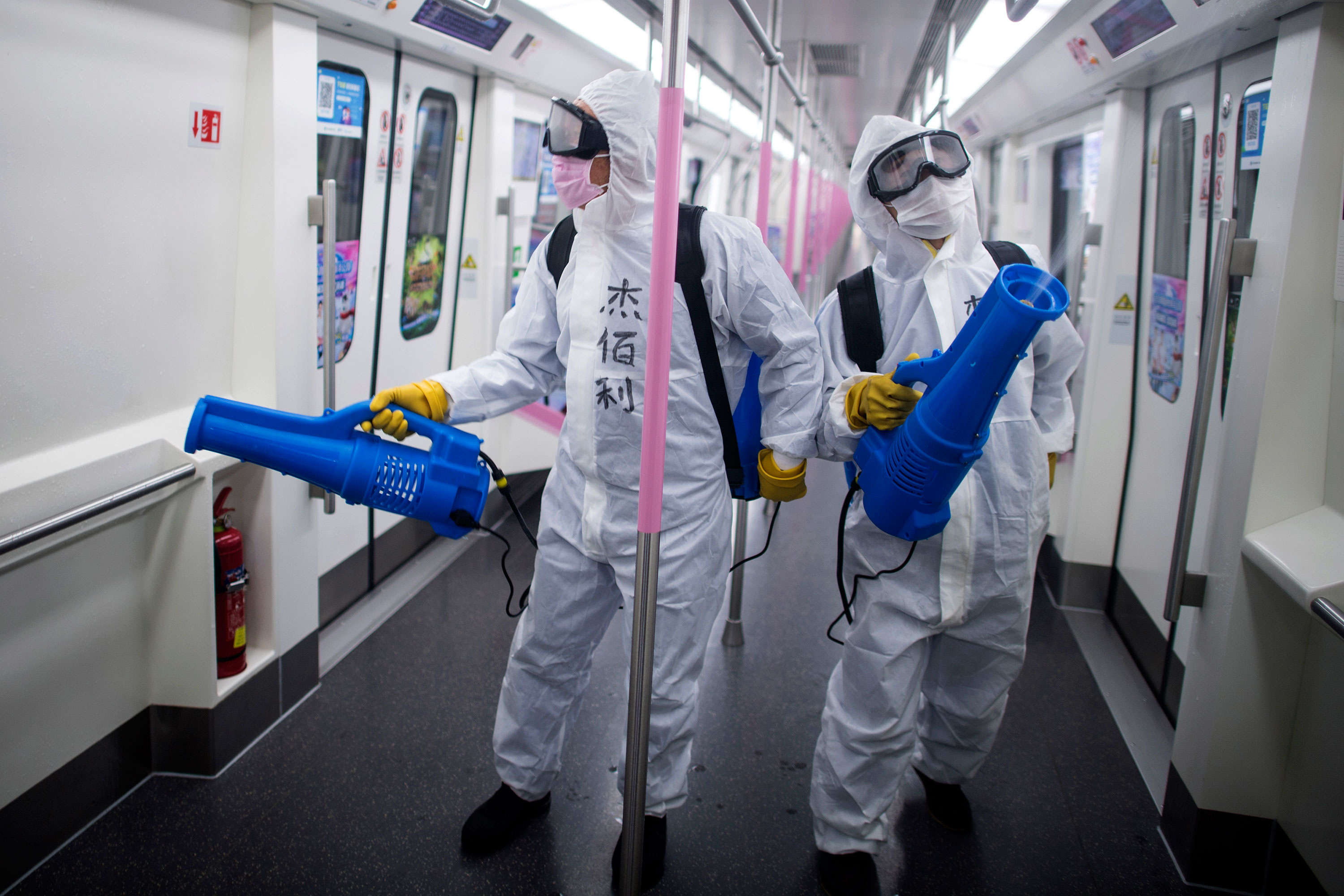 Workers disinfect a subway train on March 23 in preparation for the restoration of public transport in Wuhan, China.