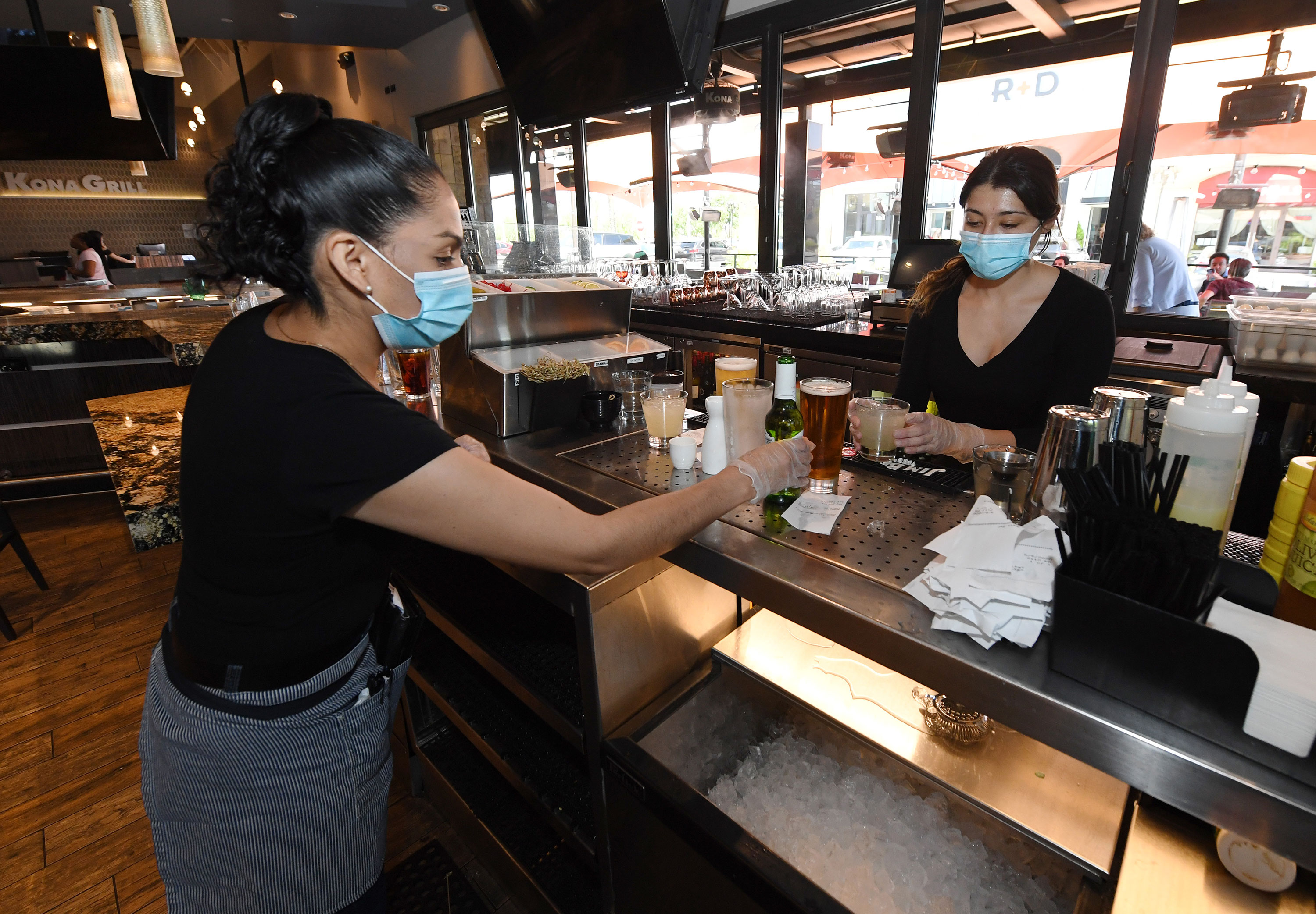 Employees at Kona Grill in Las Vegas work with facemasks on May 9 as some businesses are allowed to reopen.