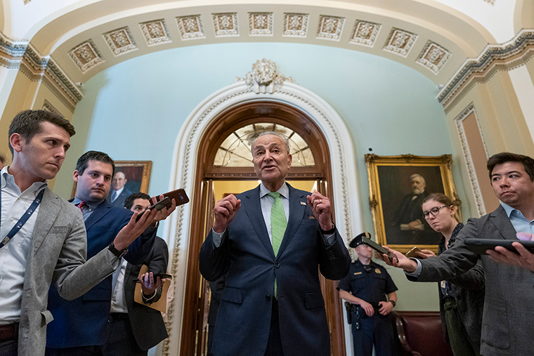 Senate Majority Leader Chuck Schumer of N.Y., speaks with reporters at the Capitol in Washington,DC, Thursday, June 24.