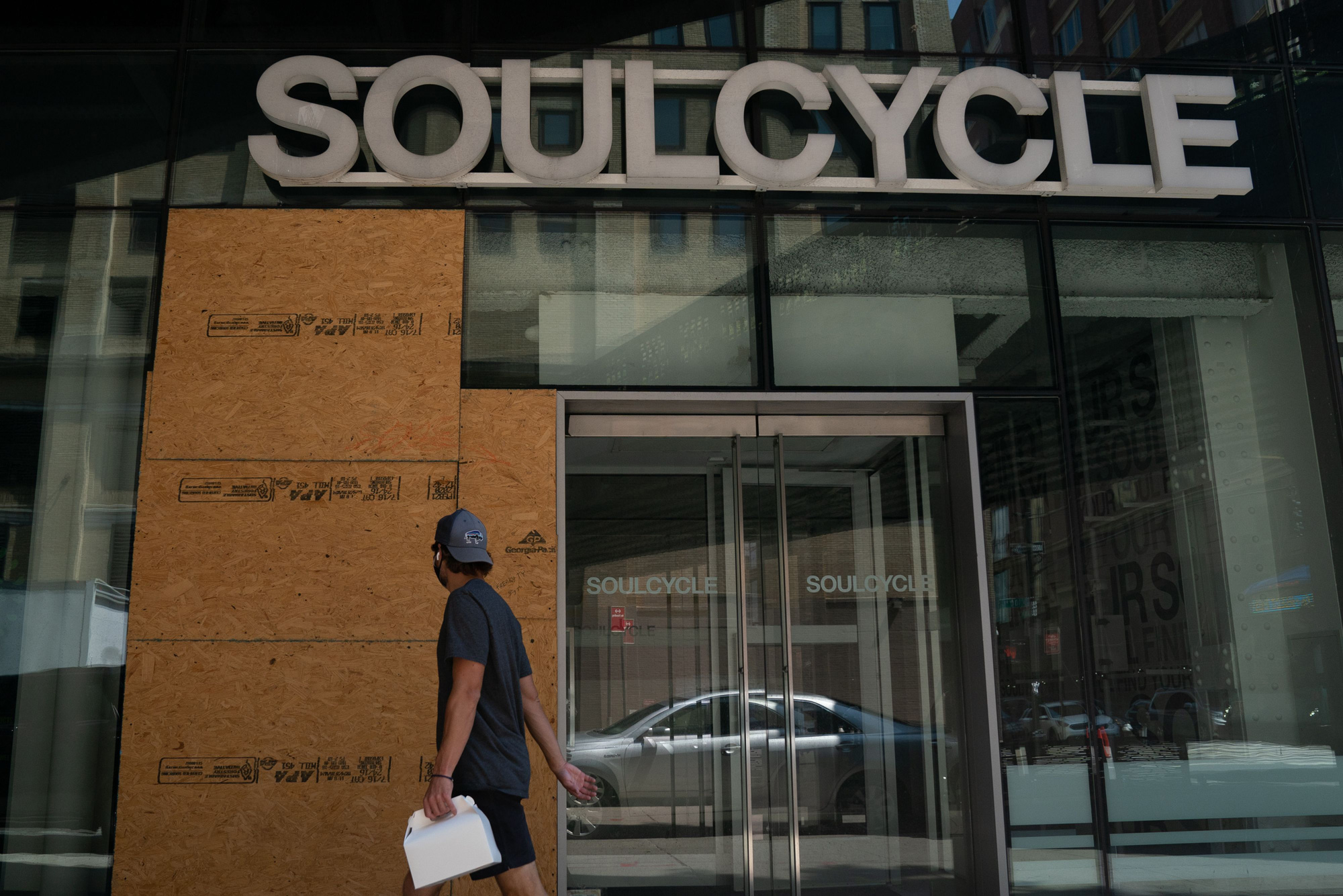 A man walks past a SoulCycle in Chelsea on August 17 in New York City.