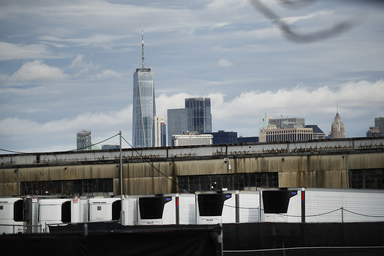 Refrigerated morgue trailers believed to be holding the bodies of people who died of Covid-19 are seen at South Brooklyn Marine Terminal on November 23, 2020 in New York City.