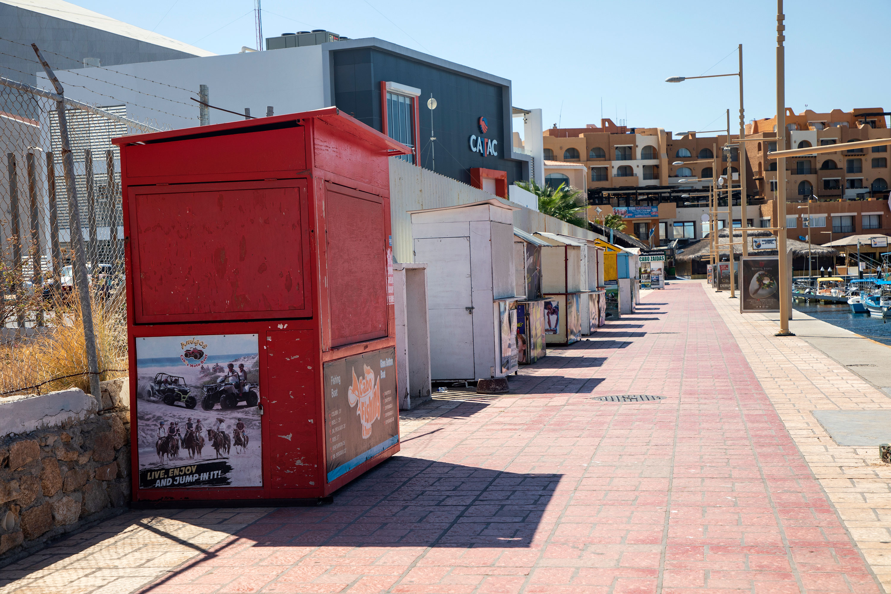 Tourist service posts remain closed in the Marina in Cabo San Lucas, Mexico, on June 2.