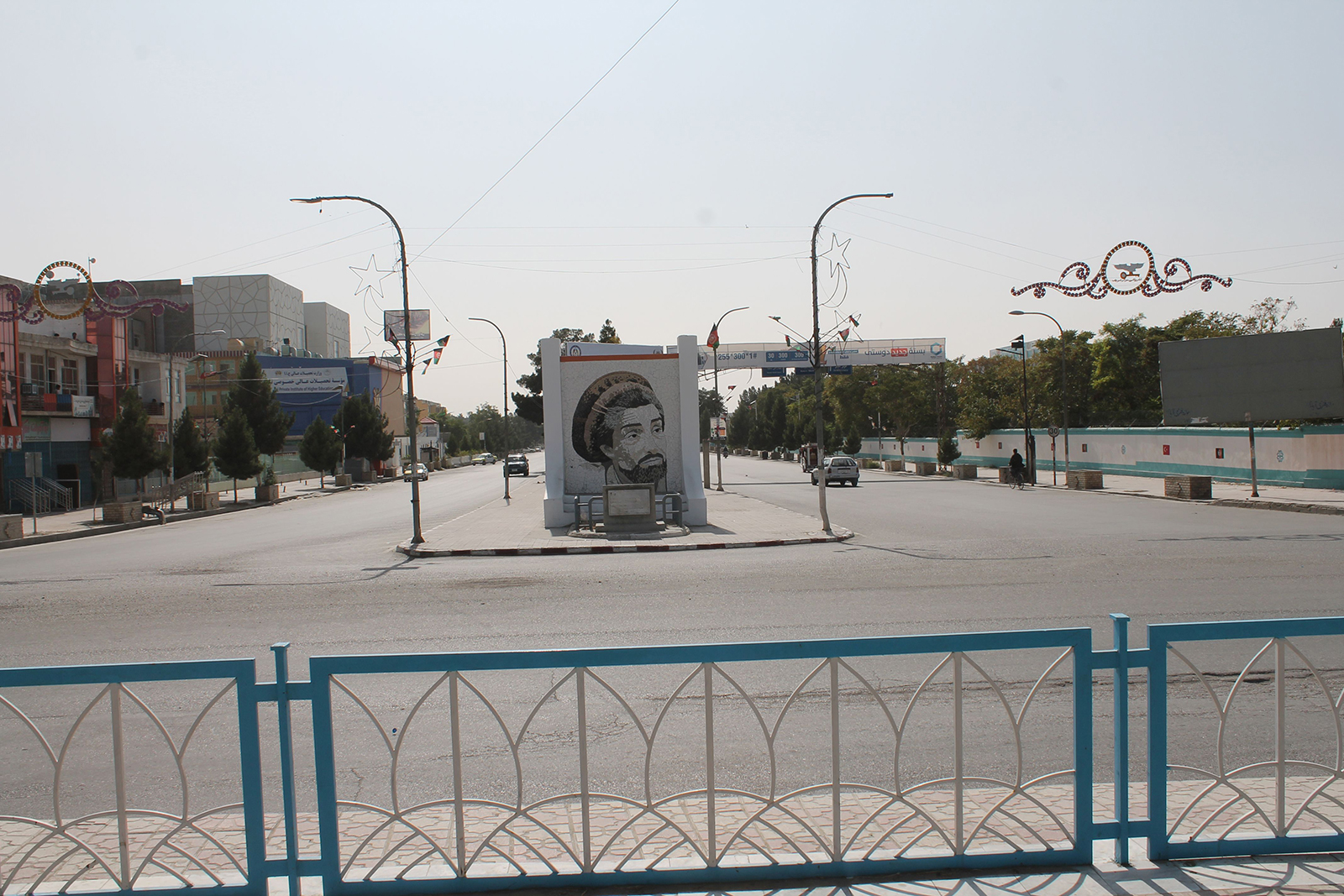 A view of a deserted road showing a monument with image of former Mujahideen commander Ahmad Shah Masoud, in Mazar-i-Sharif, the provincial capital of Balkh province, Afghanistan, on August 14.