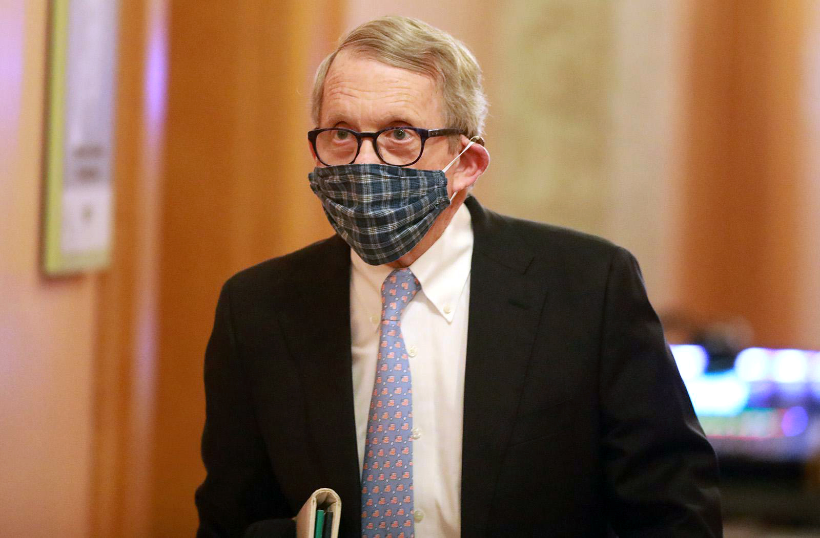 Ohio Gov. Mike DeWine walks into his daily coronavirus news conference at the Ohio Statehouse in Columbus, Ohio on April 16.