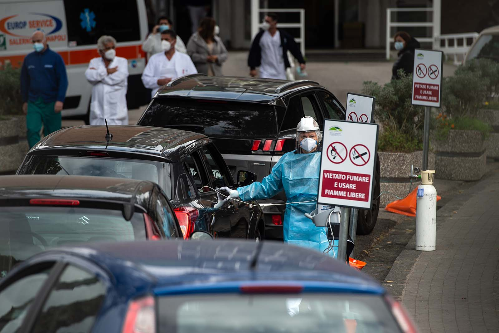 Health workers at Cotugno Hospital carry out pre-triage to a suspected Covid-19 patient on November 12, in Naples, Italy.