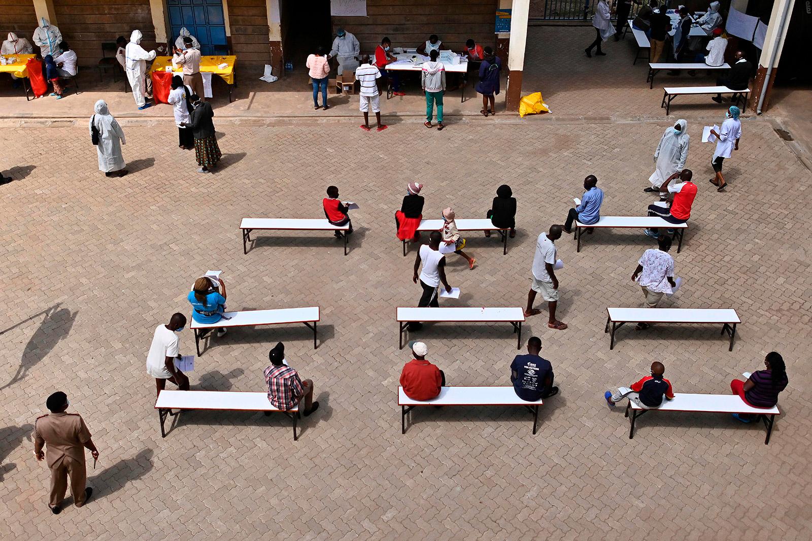 People wait to be tested for coronavirus on May 28 in Ruaraka, Kenya.