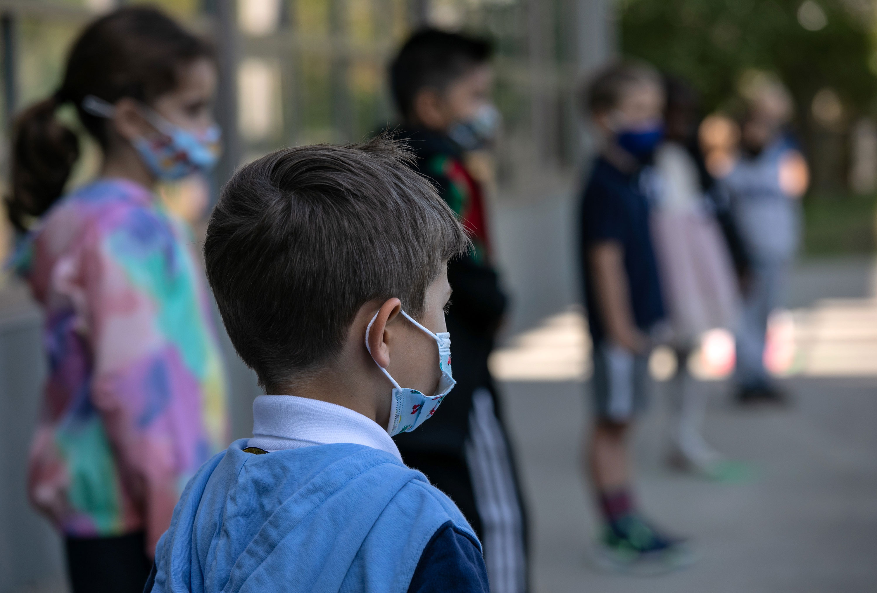Masked school children are seen in Stamford, Connecticut, in September 2020.